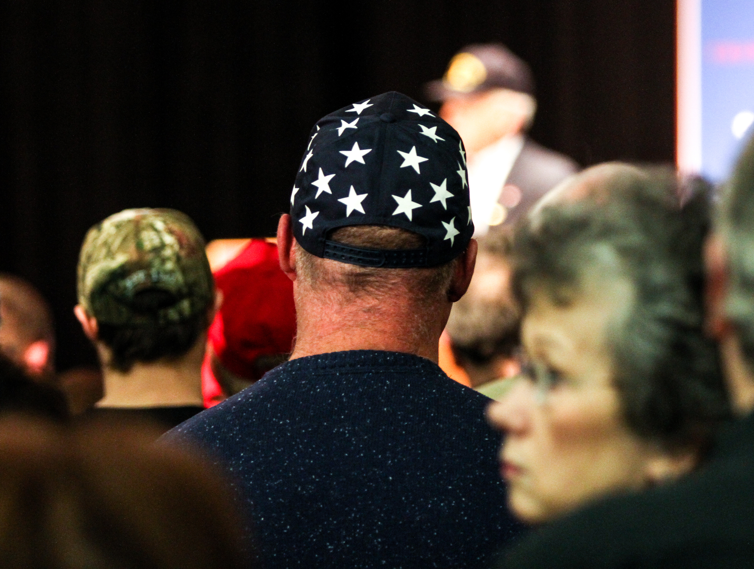 An attendee stands in a crowd of hundreds at a Donald J. Trump for President Rally at Farmington High School, 40 Thayer Dr., Farmington, NH on Jan. 26, 2016.