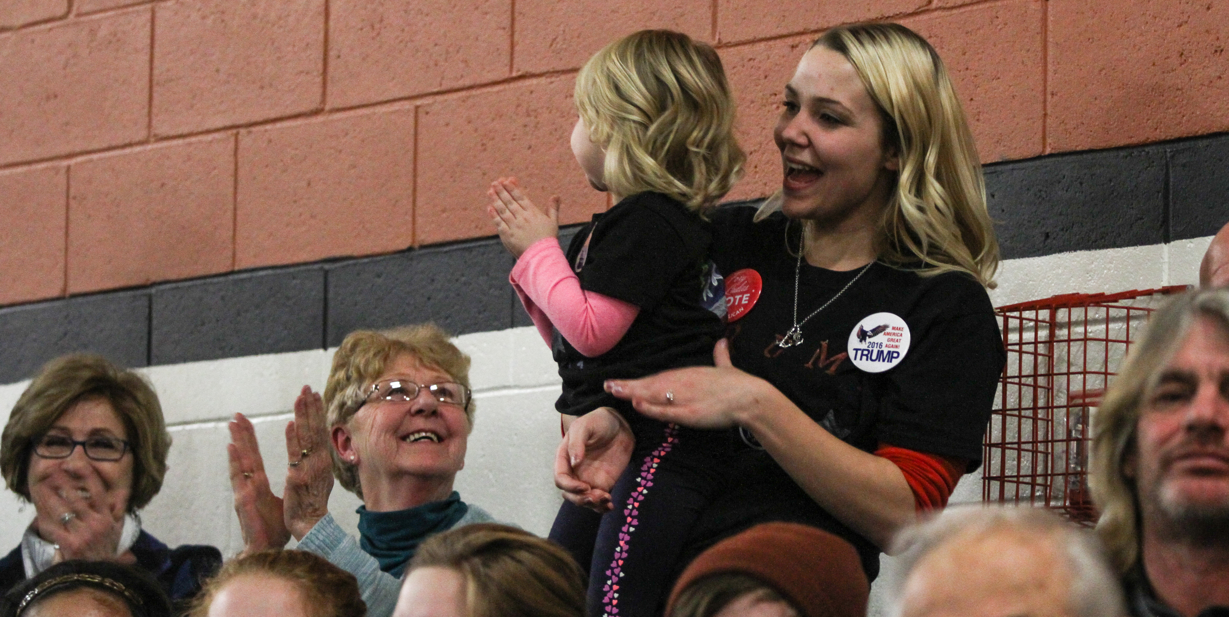 """Audience members dance and cheer as """"Don't Stop Believin'"""" by Journey plays at a Donald J. Trump for President Rally at Farmington High School, 40 Thayer Dr., Farmington, NH on Jan. 26, 2016."""