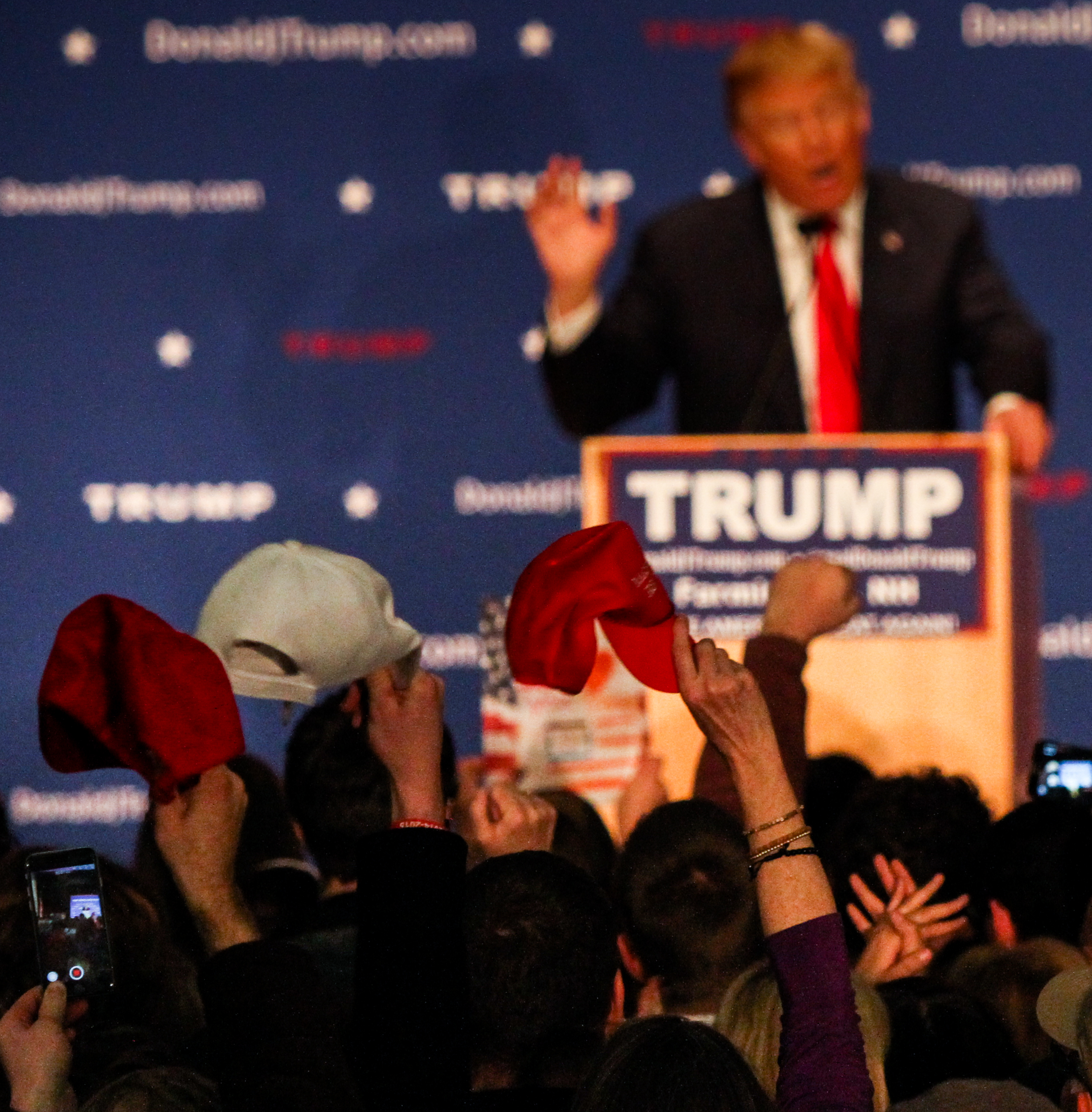 Attendees wave hats as Donald Trump speaks during a Donald J. Trump for President Rally at Farmington High School, 40 Thayer Dr., Farmington, NH on Jan. 26, 2016.