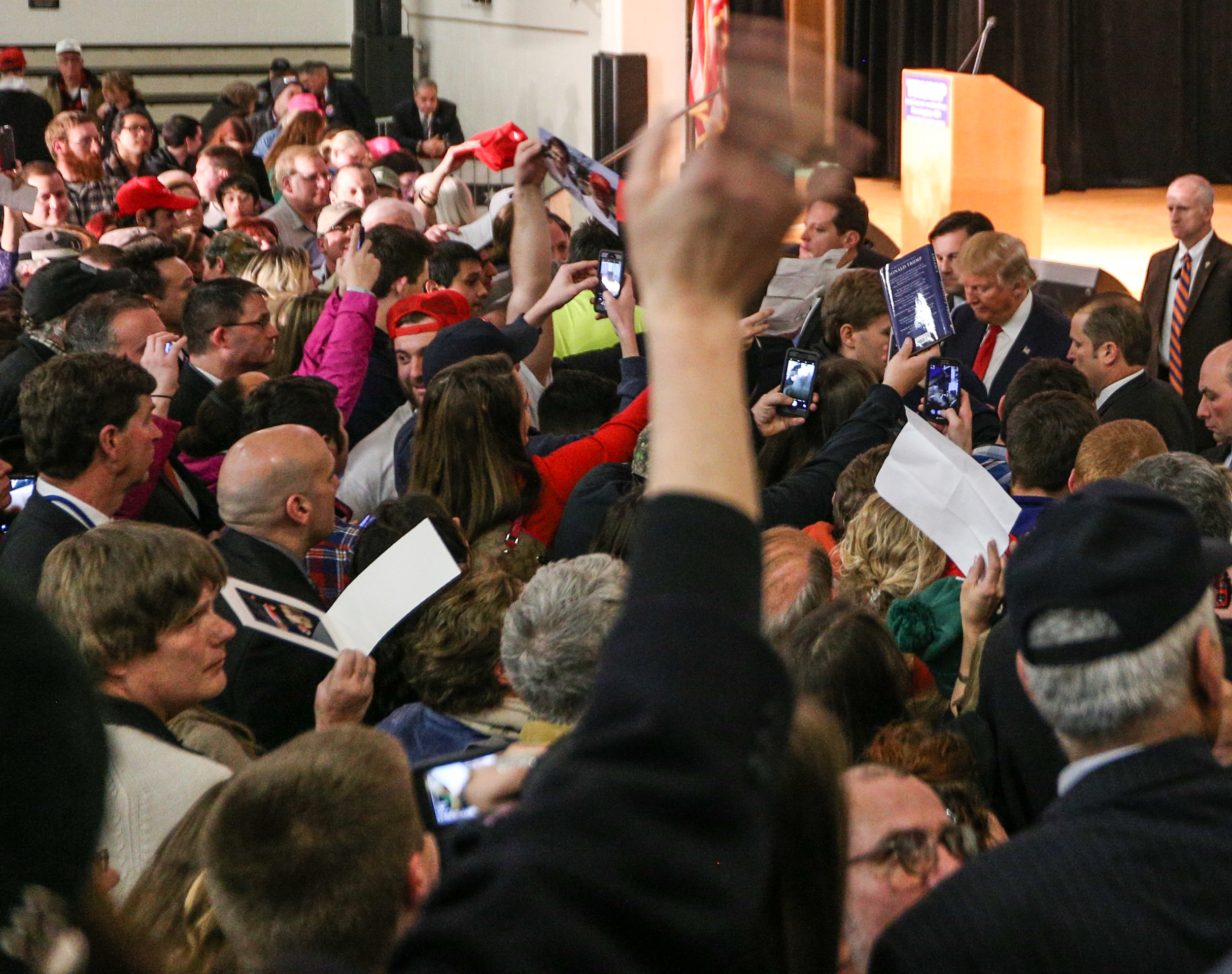 Attendees gather around Donald Trump as he signs autographs and takes photos at the conclusion of a Donald J. Trump for President Rally at Farmington High School, 40 Thayer Dr., Farmington, NH on Jan. 26, 2016.