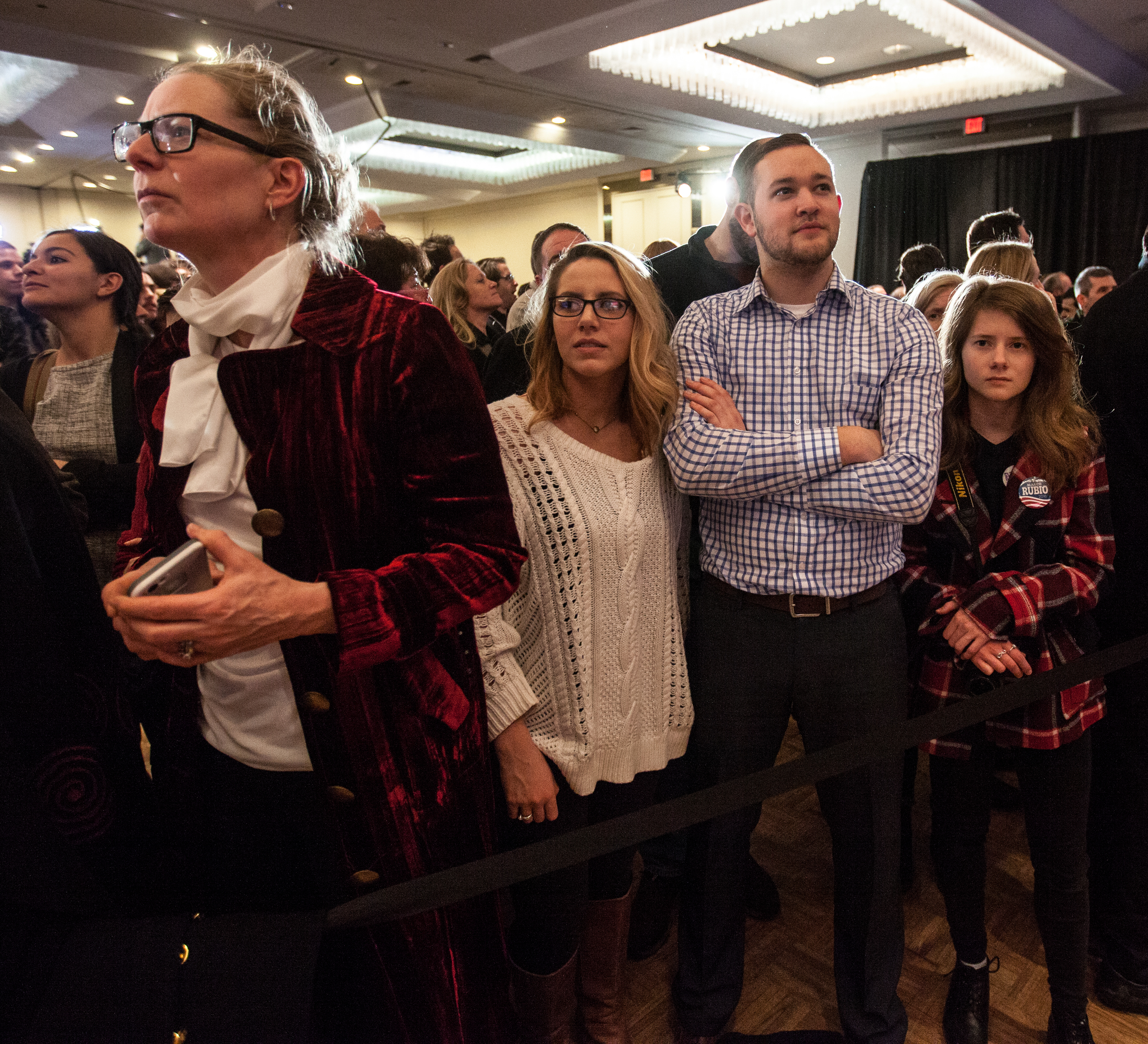 Manchester, NH, Feb. 9, 2016 - (From right) Emma Sheehan of Manchester, Brandon Castle of Albany NY, Chere Choppa of Albany NY, and Ann Lane of Durham NH, wait for primary voting results to come in at Marco Rubio's New Hampshire Primary event at the Radisson Hotel. Photo by Alexandra Wimley