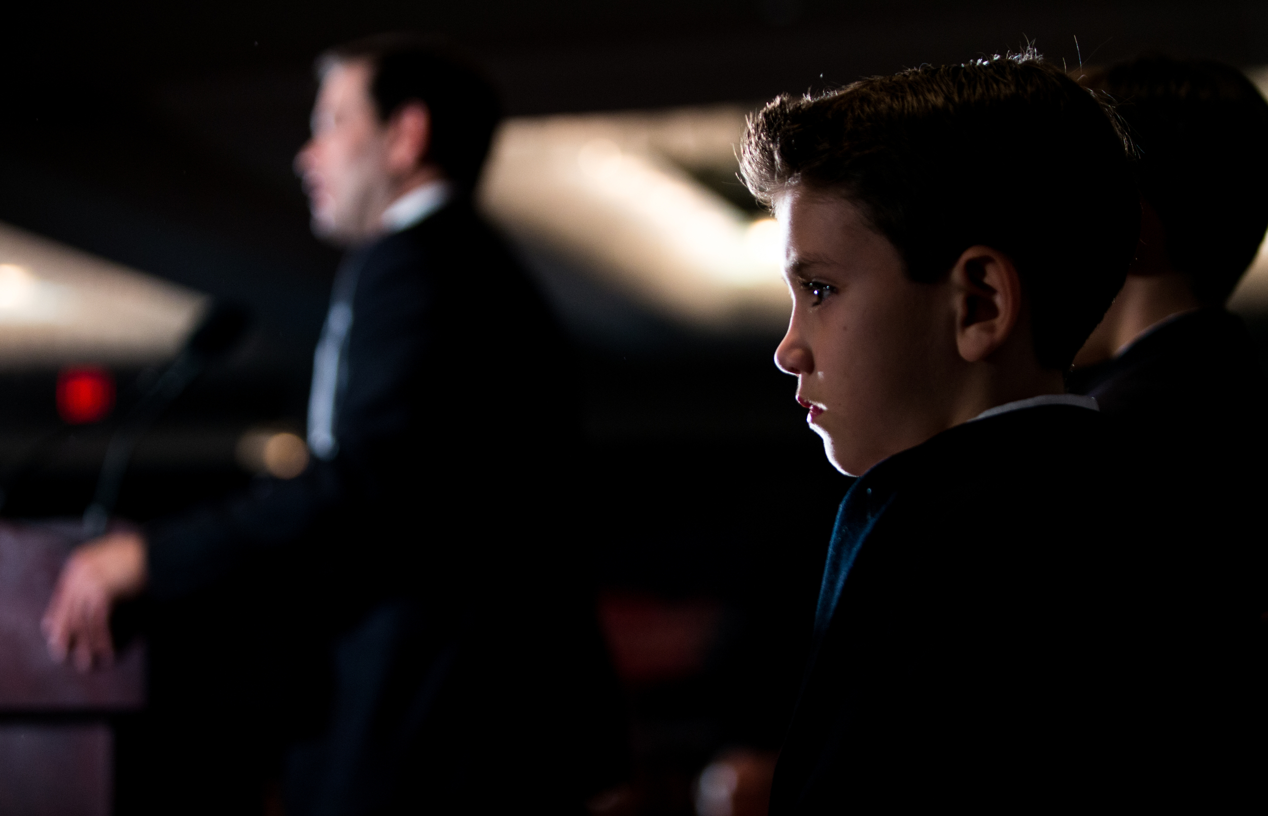 Manchester, NH, Feb. 9, 2016 - Marco Rubio's son Anthony Rubio stands on stage as his father speaks to hundreds of supporters at his New Hampshire Primary watch party at the Radisson Hotel. Photo by Alexandra Wimley