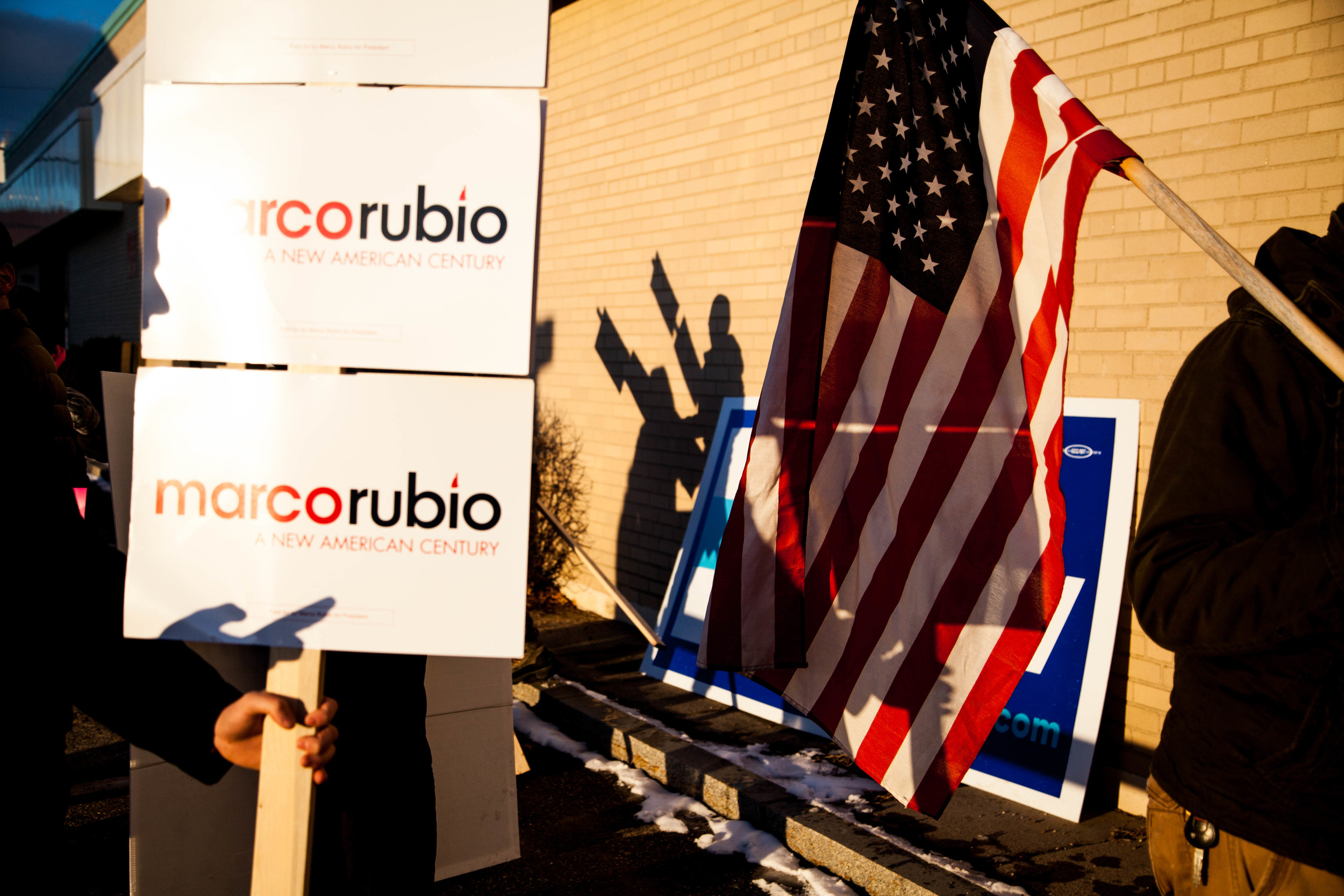 Manchester,NH, Feb. 9, 2016 - Supporters of Donald Trump, Hillary Clinton and Marco Rubio stand side by side to talk to voters as they enter a polling station at the Manchester Health Department. Photo by Alexandra Wimley