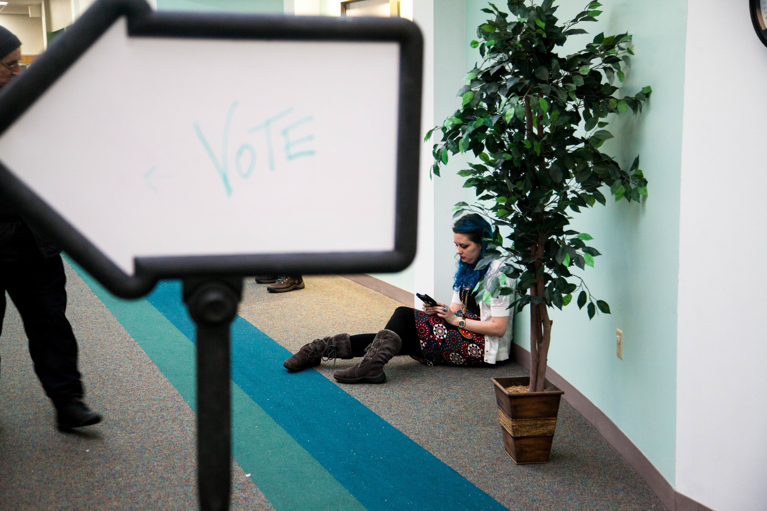 Manchester, NH, Feb. 9, 2016 - Diana Freshette, of Manchester, waits until the line shortens to vote at a polling station at the Manchester Health Department. Photo by Alexandra Wimley