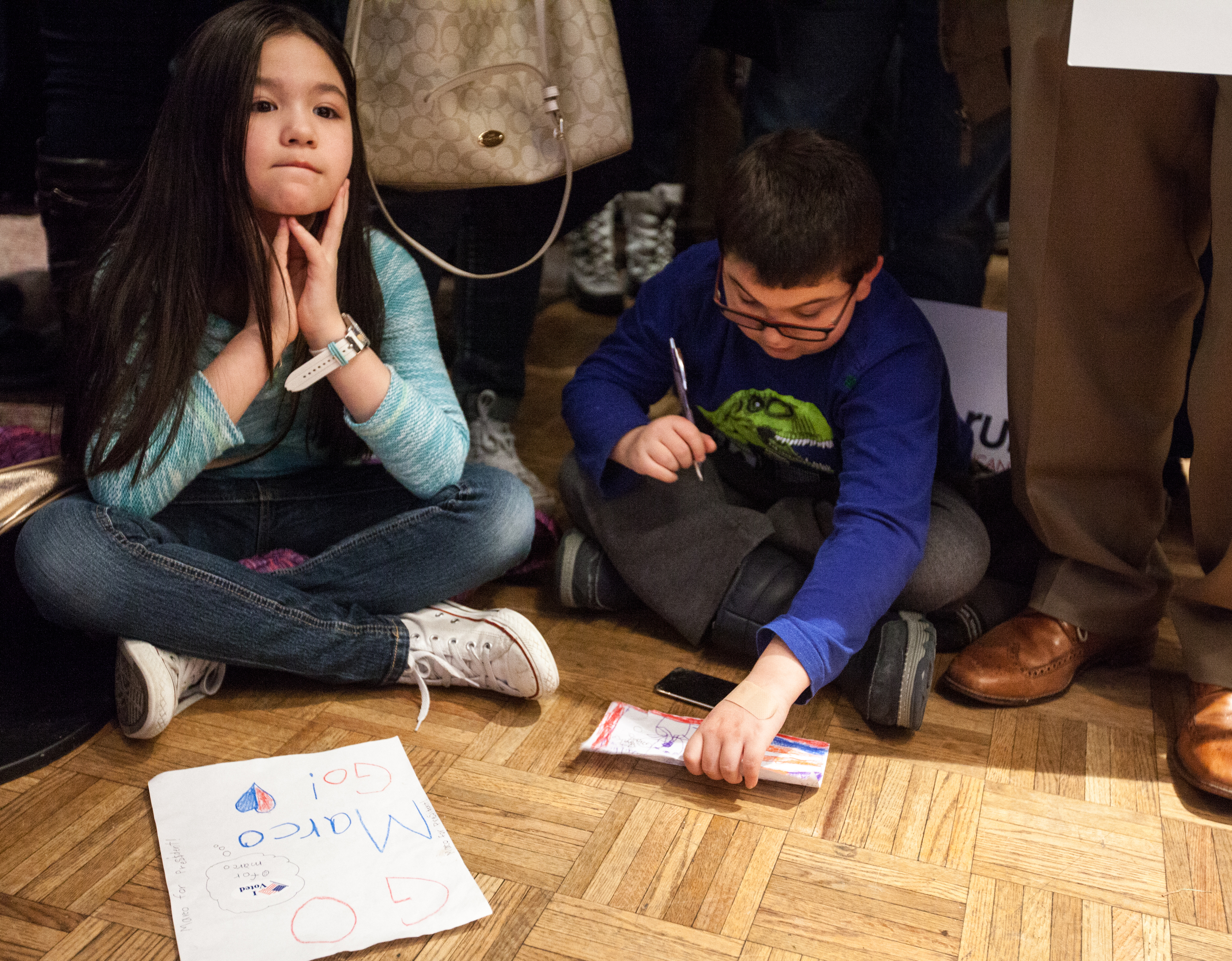 Manchester, NH, Feb. 9, 2016 - Jayden Walls, 8 (left), and Mark Mooers, 9, both of Manchester, wait for Marco Rubio to speak at his New Hampshire Primary watch party at the Radisson Hotel. Photo by Alexandra Wimley