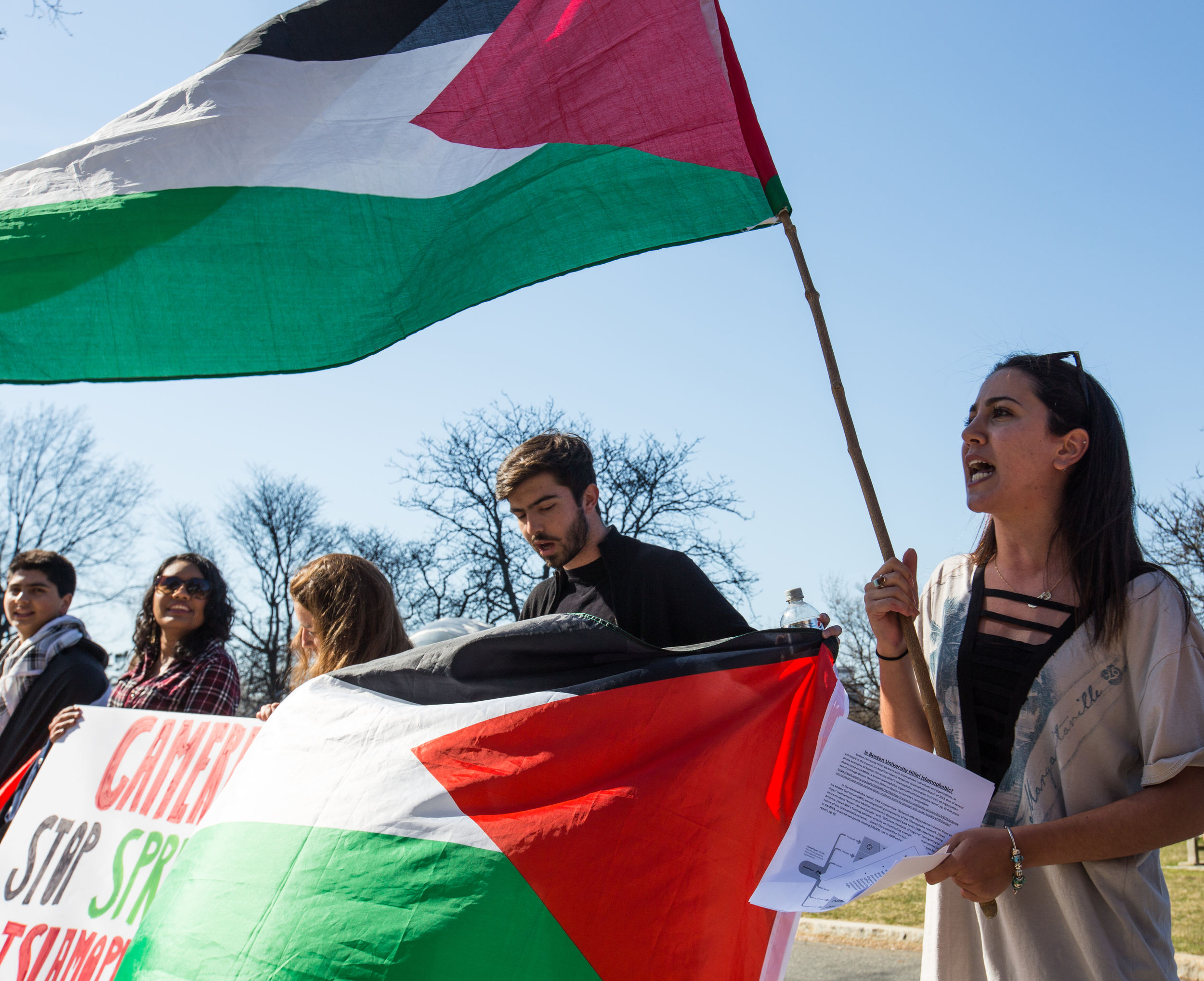 Boston Students for Justice in Palestine members march in front of Marsh Chapel on the Boston University Beach.