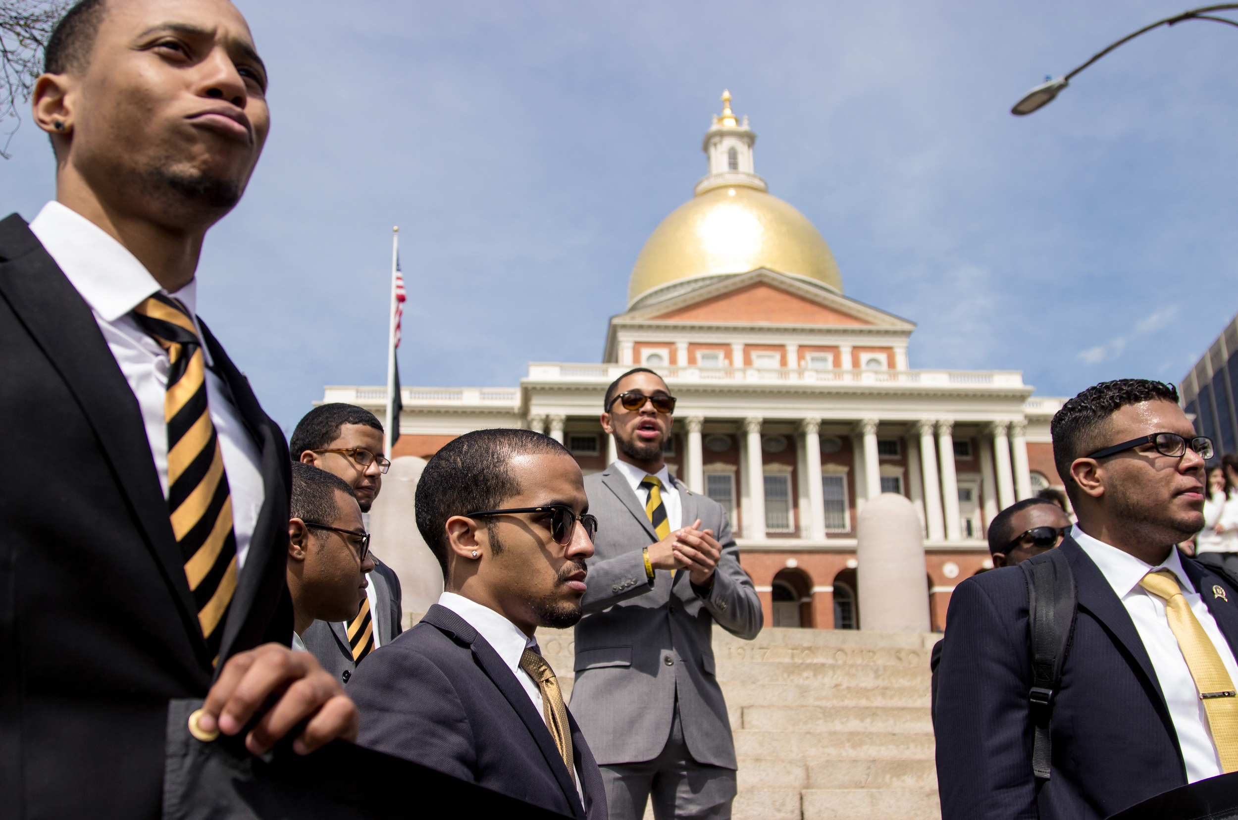 Brothers of the Sigma chapter of Alphi Phi Alpha (from left) William Belt, Yassine El Yousfi, Jamil Williams, and Ricky Rodriguez stand in front of the Massachusetts State House in Boston, Mass., on April 9, 2016, after leading a march from Marsh Plaza to speak out against Donald Trump's ideas and messages.