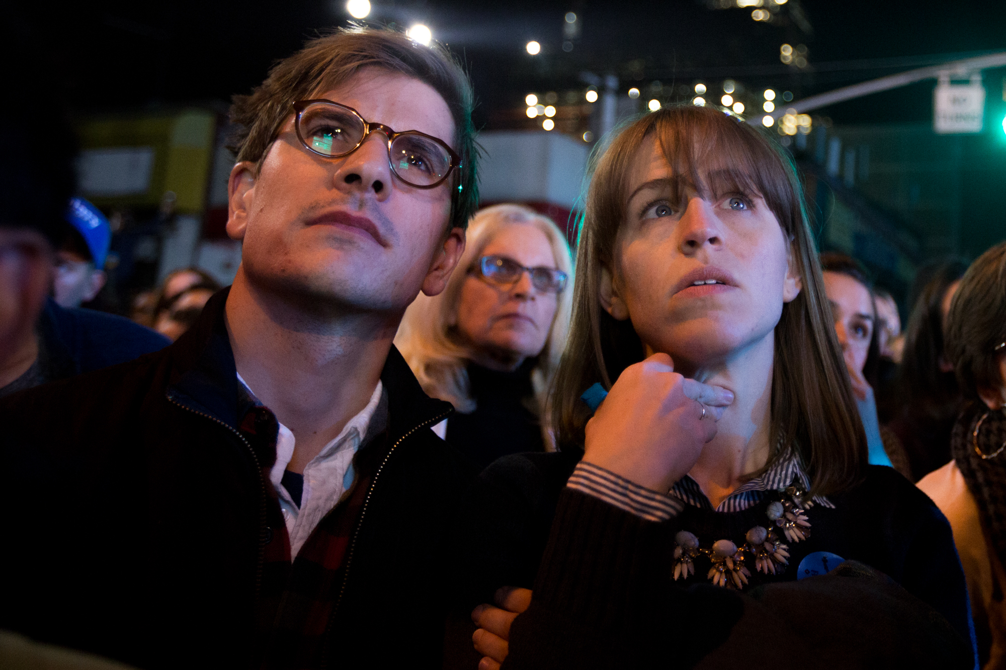 Attendees watch commentary and commercials on the big screen television during Hillary Clinton's Election Night Event outside of the Jacob K. Javits Convention Center, Nov. 8, 2016. News broadcasts were interspersed with commercials from Clinton's campaign and speakers on the stage outside.