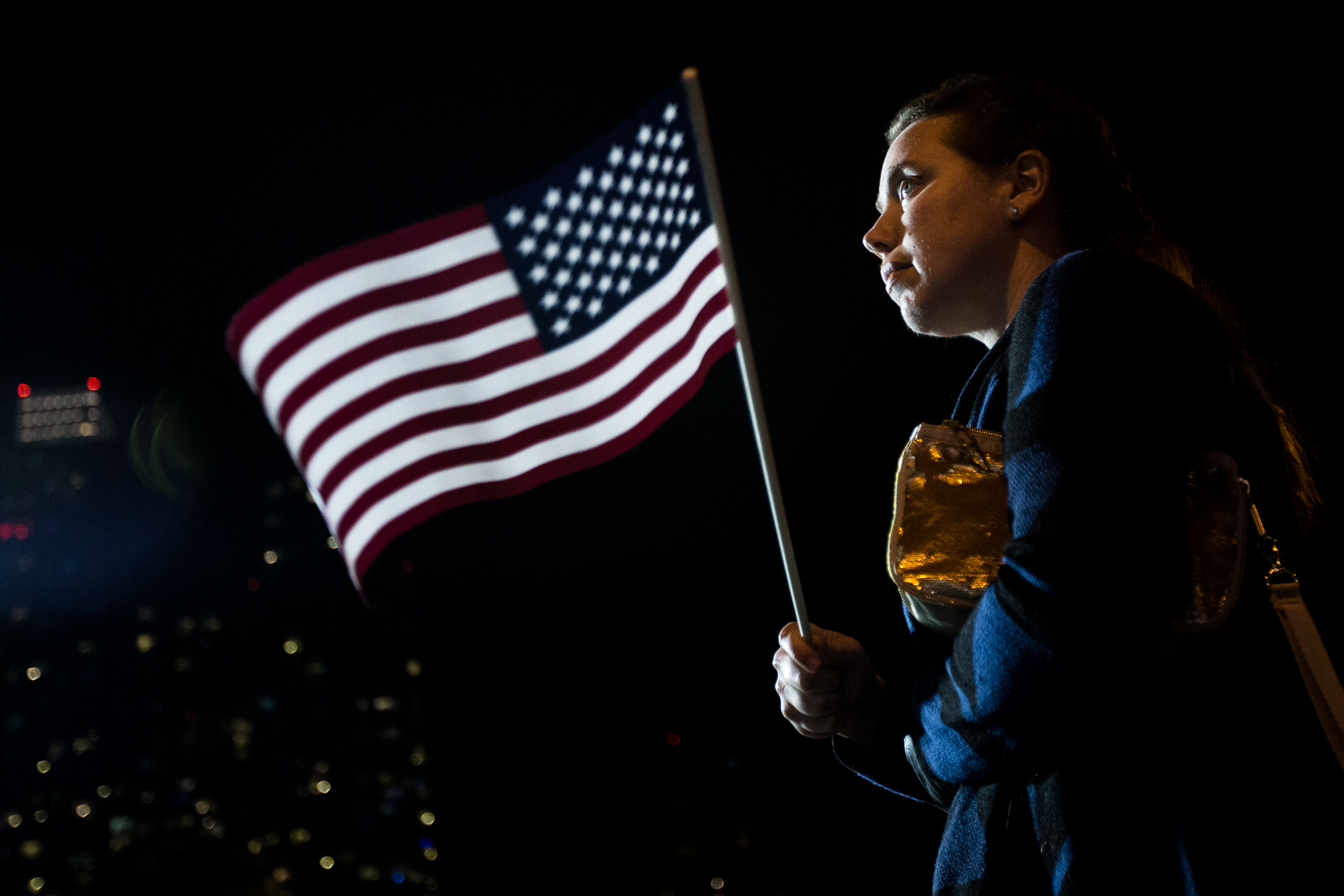 Fiona Russo, of New York, waves a flag as the venue began to clear out when it became clear Trump would win the presidency during Hillary Clinton's Election Night Event outside the Jacob K. Javits Convention Center, in the early hours of Nov. 9, 2016. She, along with dozens of other supporters, stayed until about 2 a.m. She continued standing and waving her flag until Clinton's campaign manager announced that Clinton would not be speaking.