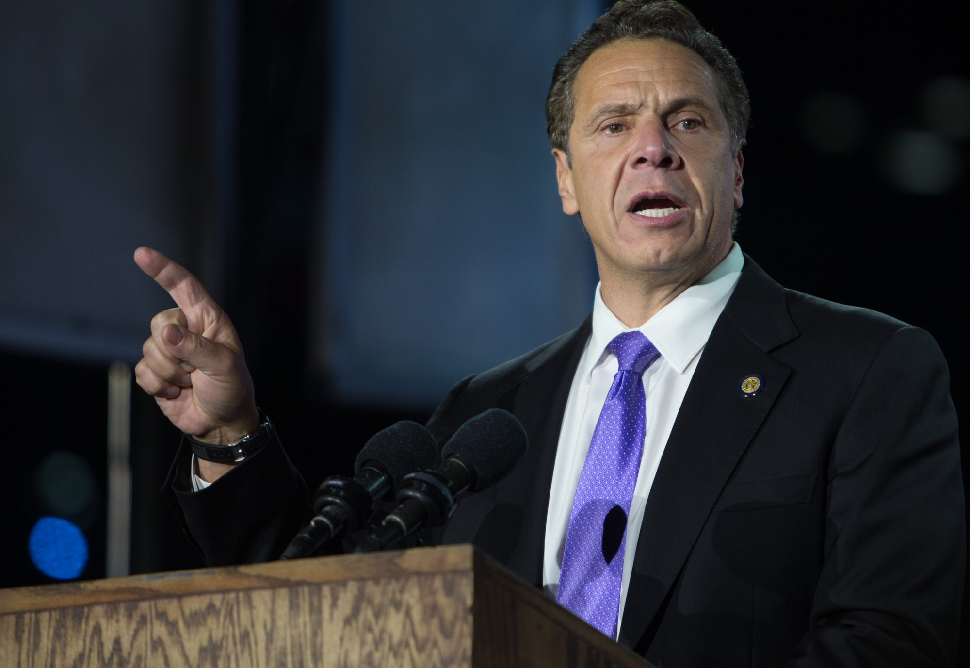 """New York Governor Andrew Cuomo addresses the audience outside the Jacob K. Javits center, Nov. 8, 2016. Cuomo,who spoke after New York Mayor Bill de Blasio, was optimistic about a Clinton victory. """"This is going to be a great night when it's over. I believe that,"""" he said."""