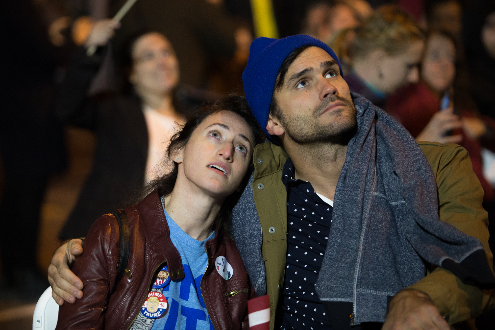 Danielle Russo (left) and Luke Ohlson, both of New York, comfort each other while watching commentary on the big screen television outside of the Jacob K. Javits Convention Center in the early hours of Nov. 9, 2016.