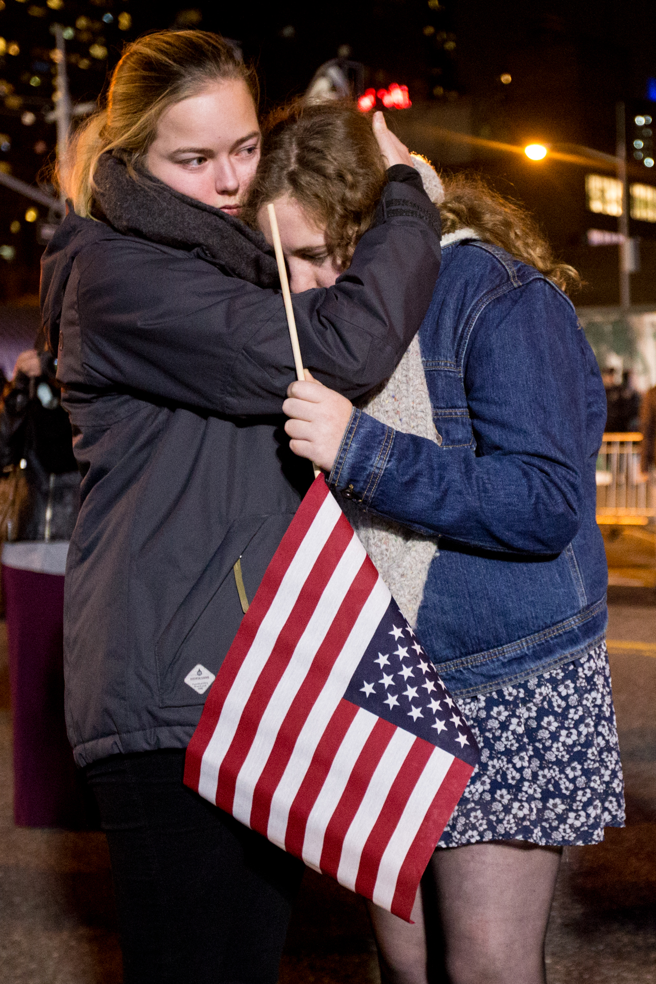 Supporters comfort each other around 1 a.m. while waiting to find out if Clinton will give a concession speech that night. Though the venue emptied some, about 100 supporters still waited outside the Jacob K. Javits Convention Center Until about 2 a.m on Nov. 9, 2106.