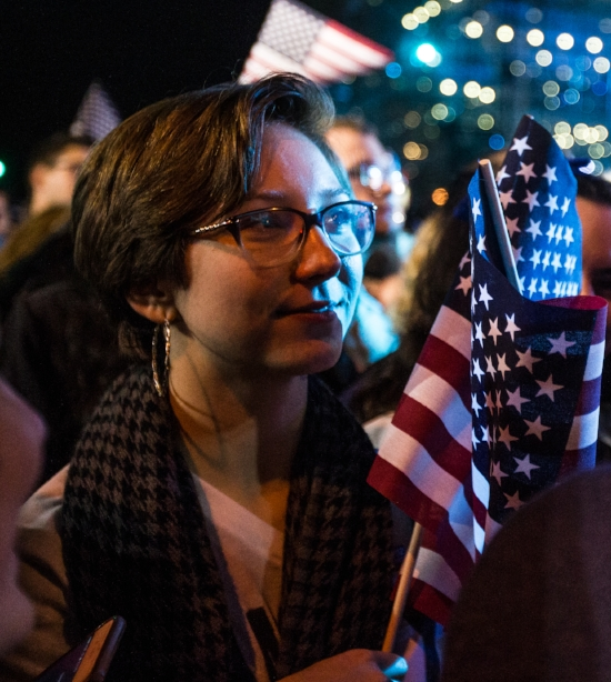 Mary Markovitz, of Connecticut, smiles while watching results come in early in the night at Hillary Clinton's Election Night Event outside the Jacob K. Javits Convention Center, New York, Nov. 8, 2016.
