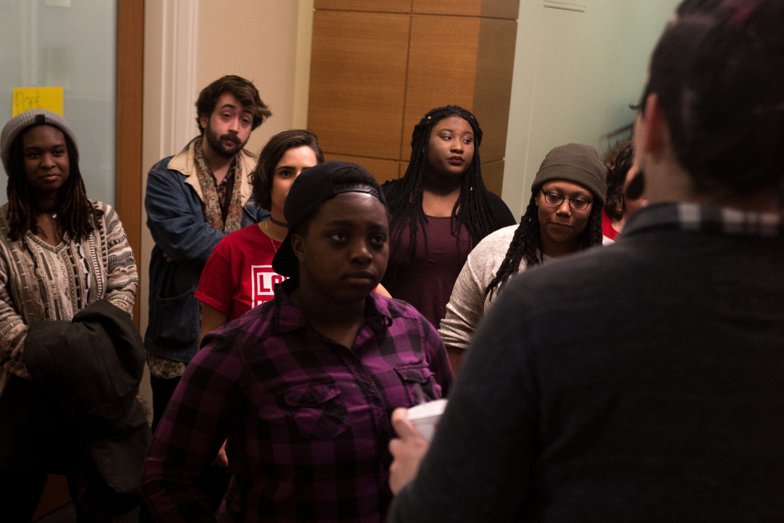 Pierresaint listens to instructions before judging a college slam poetry competition at Simmons College, Boston, March 31.