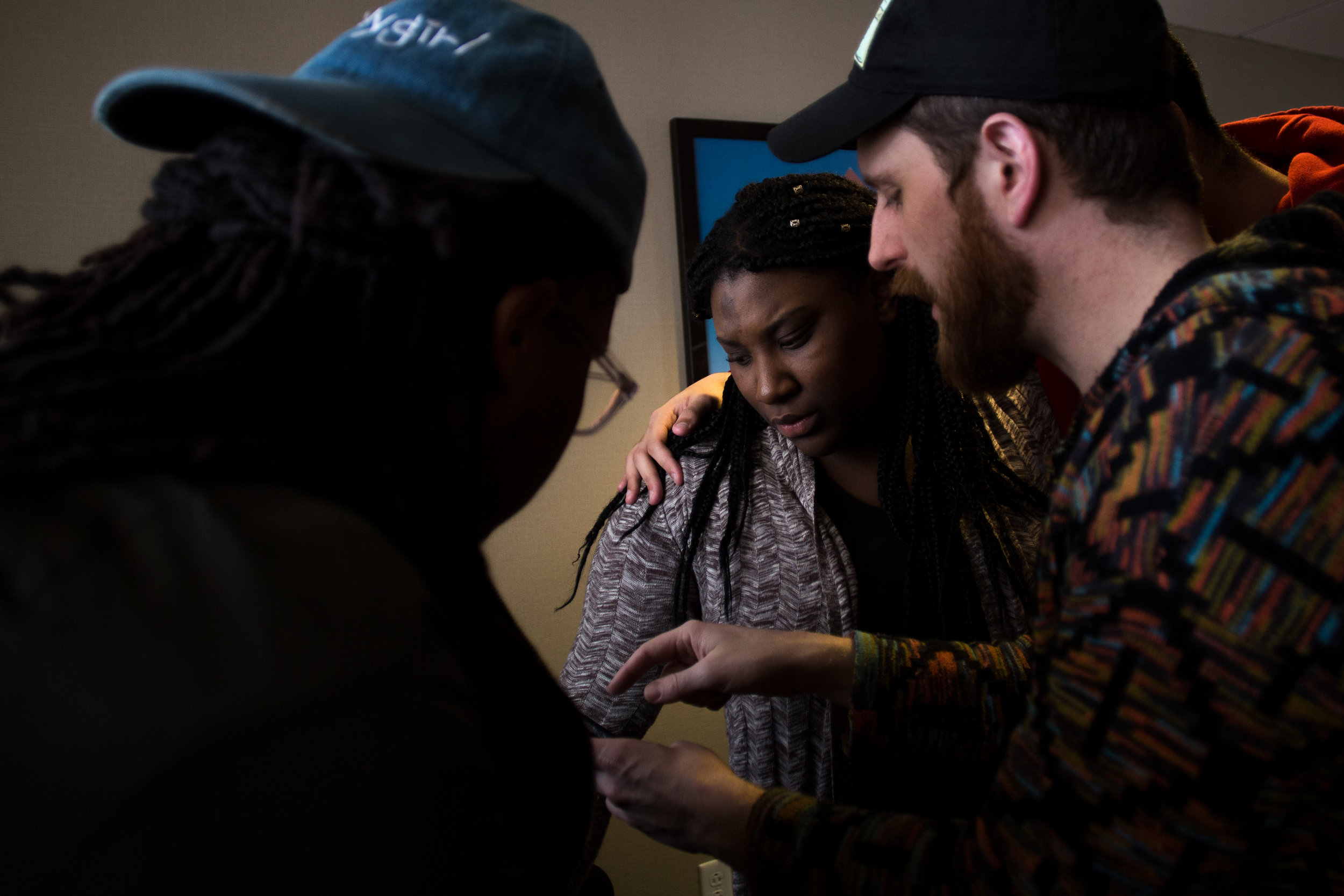 Pierresaint's coaches give her last minute advice before performing her first individual poem in the preliminary round of Louder Than a Bomb in Boston, April 8.