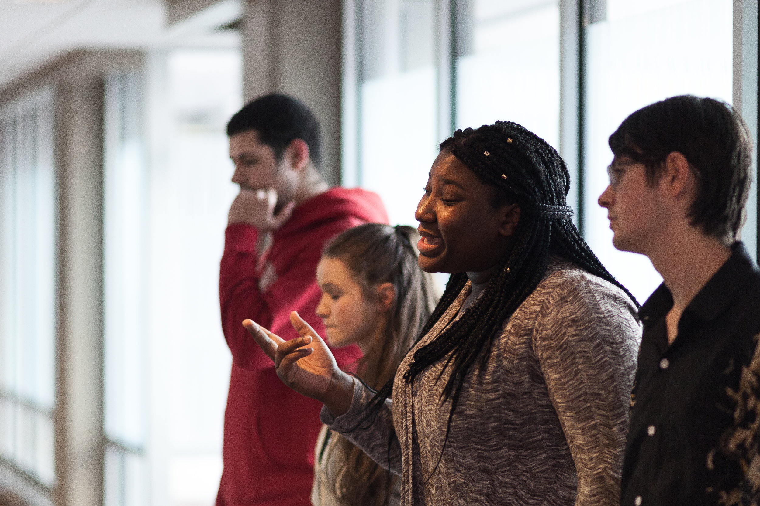 Pierresaint's team Books of Hope rehearses their poem before performing in the preliminary stage of Louder Than A Bomb, a national youth poetry competition April 8 in Boston.