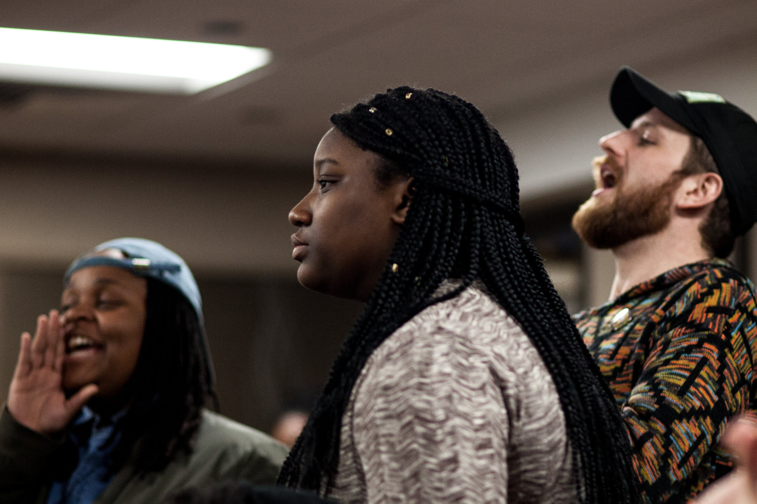 Pierresaint's coaches cheer her on as she walks up to the mic for her final bout in the preliminaries of Louder Than A Bomb. Pierresaint qualified to compete in the individual finals April 29 in Boston.