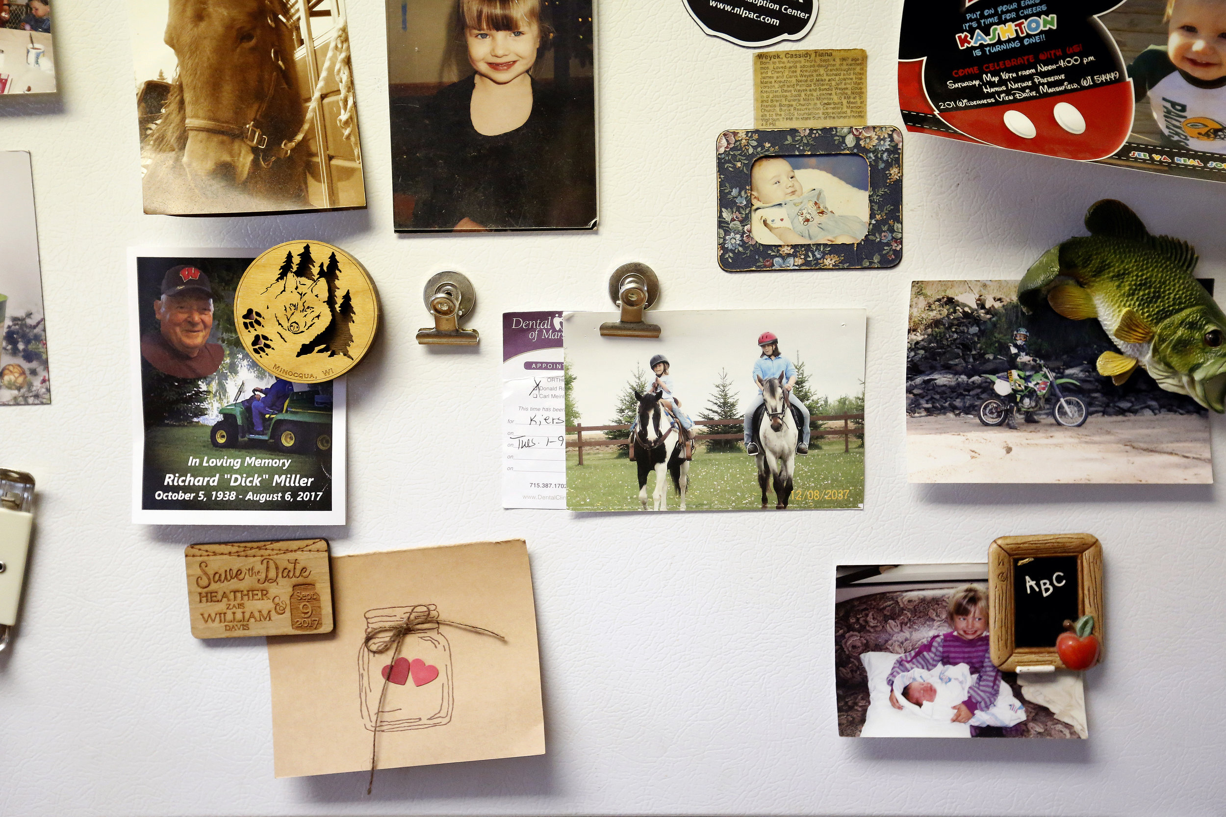 Family photos and memorabilia decorate the refrigerator in Rogowski's childhood home.