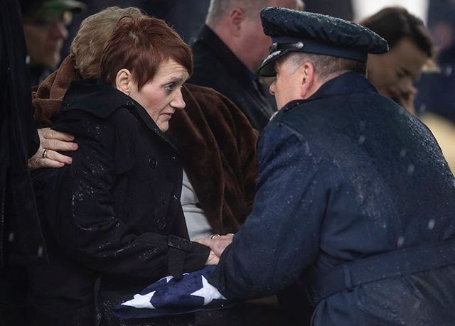 Dawna Bogolea Elchin Duez receives the American flag from Lt. General Brad Webb during the burial service for her son Staff Sgt. Dylan Elchin at Arlington National Cemetery, Thursday, Jan. 24, 2019, in Arlington, Va. Elchin and two other servicemen were killed after their vehicle was destroyed by an improvised explosive device in Afghanistan in November. (Alexandra Wimley/Post-Gazette)
