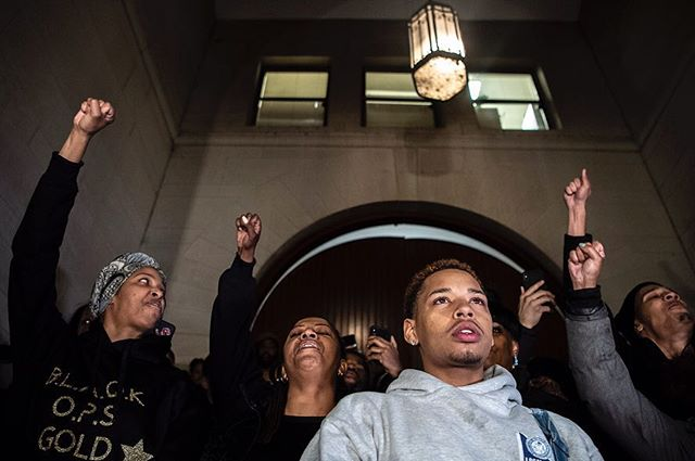 Christian Carter, center right, pauses after reading a poem Antwon Rose II wrote in high school before leading protesters in chants in front of the courthouse after a jury found former officer Michael Rosfeld not guilty in the fatal shooting of 17-year-old Antwon Rose II, yesterday in Downtown Pittsburgh. (Alexandra Wimley/Post-Gazette)