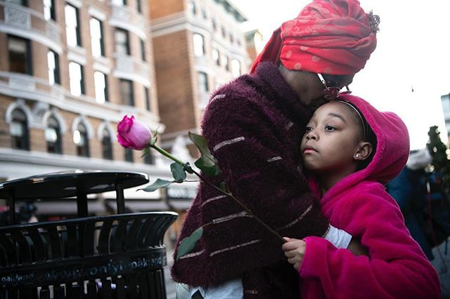 Deirdre Wilkerson hugs and kisses her granddaughter Barisa Wellons, 7, both of Homestead, during a protest march this afternoon on Forbes Avenue in Oakland the day after former officer Michael Rosfeld was found not guilty in the fatal shooting of Antwon Rose II. (Alexandra Wimley/Post-Gazette)