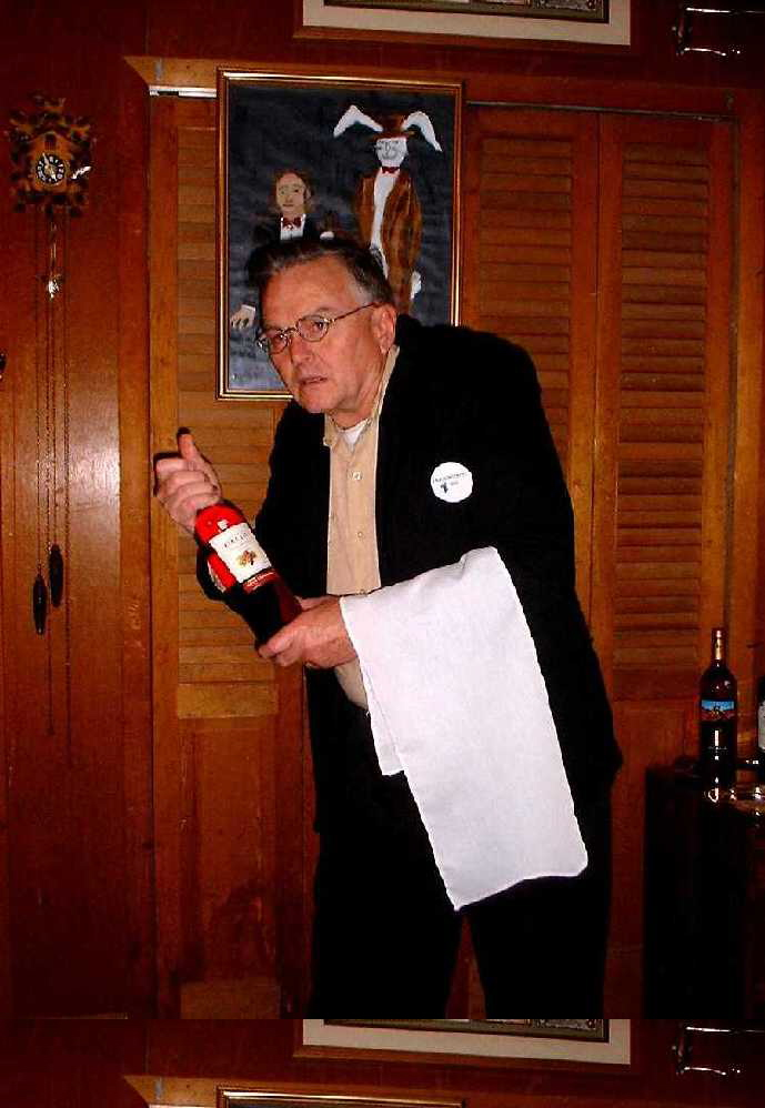 My dad playing a hunchback waiter at one murder mystery party-