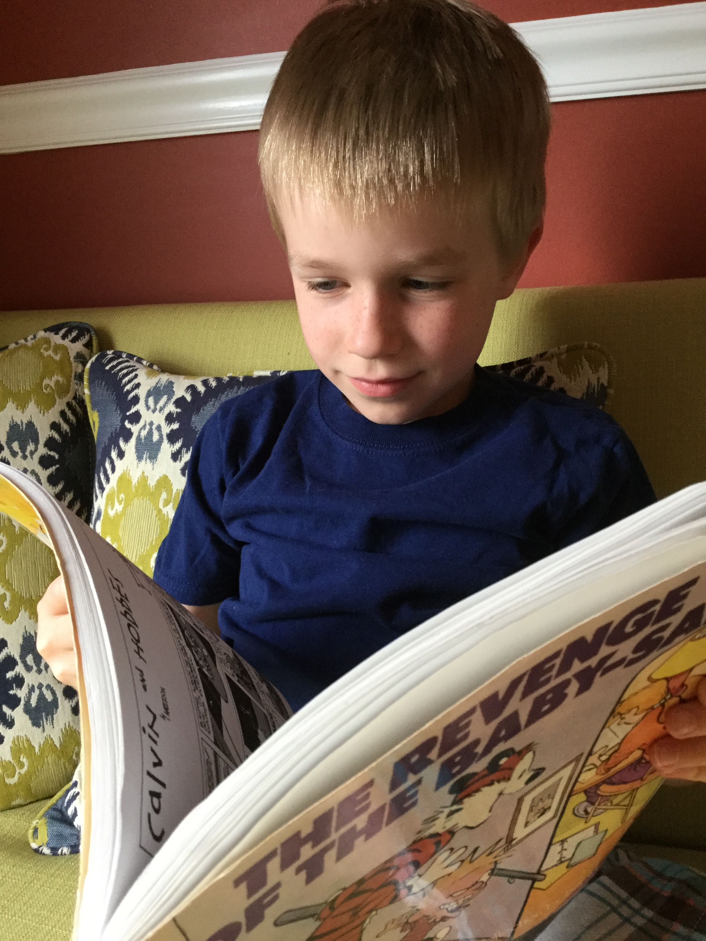 My 7-year-old with his new favorite book series.