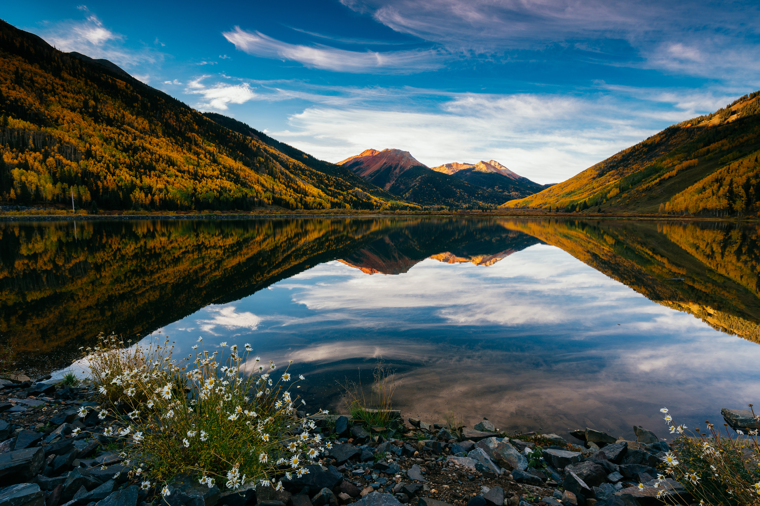 Just off of U.S. Highway 550 going over Red Mountain Pass is a small but beautiful alpine lake called Crystal Lake. The glass-like reflections of the lake provide so many angles and just a flat out gorgeous view of the San Juan mountains! There were a few other photographers around on this morning, but far less than I was expecting for such a stunning mountain scene.