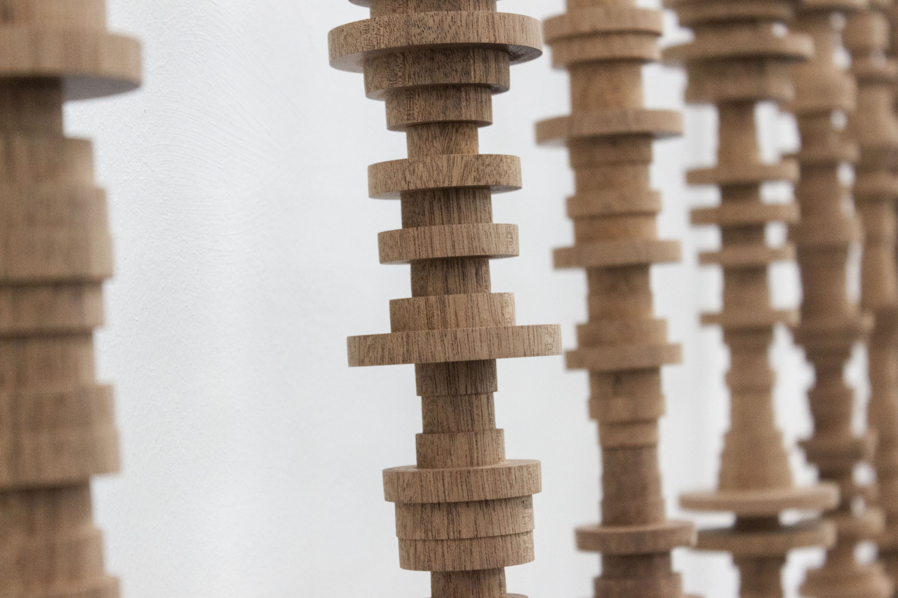 HK-MK, 21 mahogany poles, book, 230 x 500 x 20 cm, 2015 (detail)