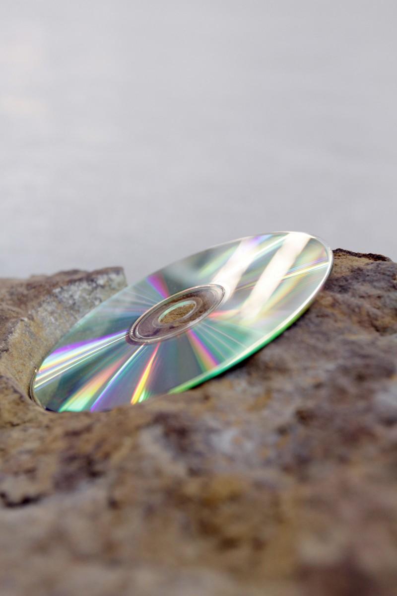 Beginning Happening, 2011, Travertine, archival compact disc, 23 x 87 x 33 cm