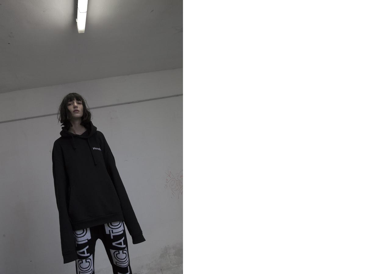 Clara wears hoodie   VETEMENTS   pants   NICOLA INDELICATO