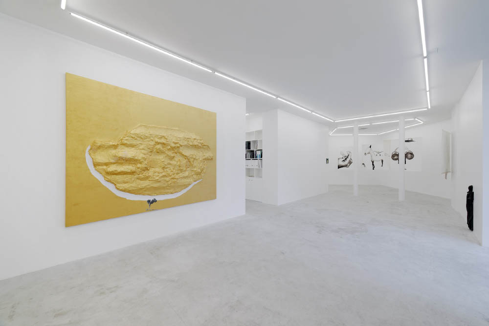 Enzo Cucchi - Exhibition view (Dec. 14th, 2017 - Feb. 3rd, 2018) from Balice Hertling's new Paris space ' Arts & Métiers ' at 239, rue Saint-Martin, in the 3rd arrondissement.   Enzo's artwork on the left (gold painting):   Pietra , 2017, Oil and acrylic on resin and shaped canvas, 220 x 310 x 25 cm (86 5/8 x 122 x 9 7/8 in.)  Enzo's artwork on the right (statue against the wall):  La madonna con la campana che suona , 2017, Bronze, 100 x 40 x 12 cm (39 3/8 x 15 3/4 x 4 3/4 in.)