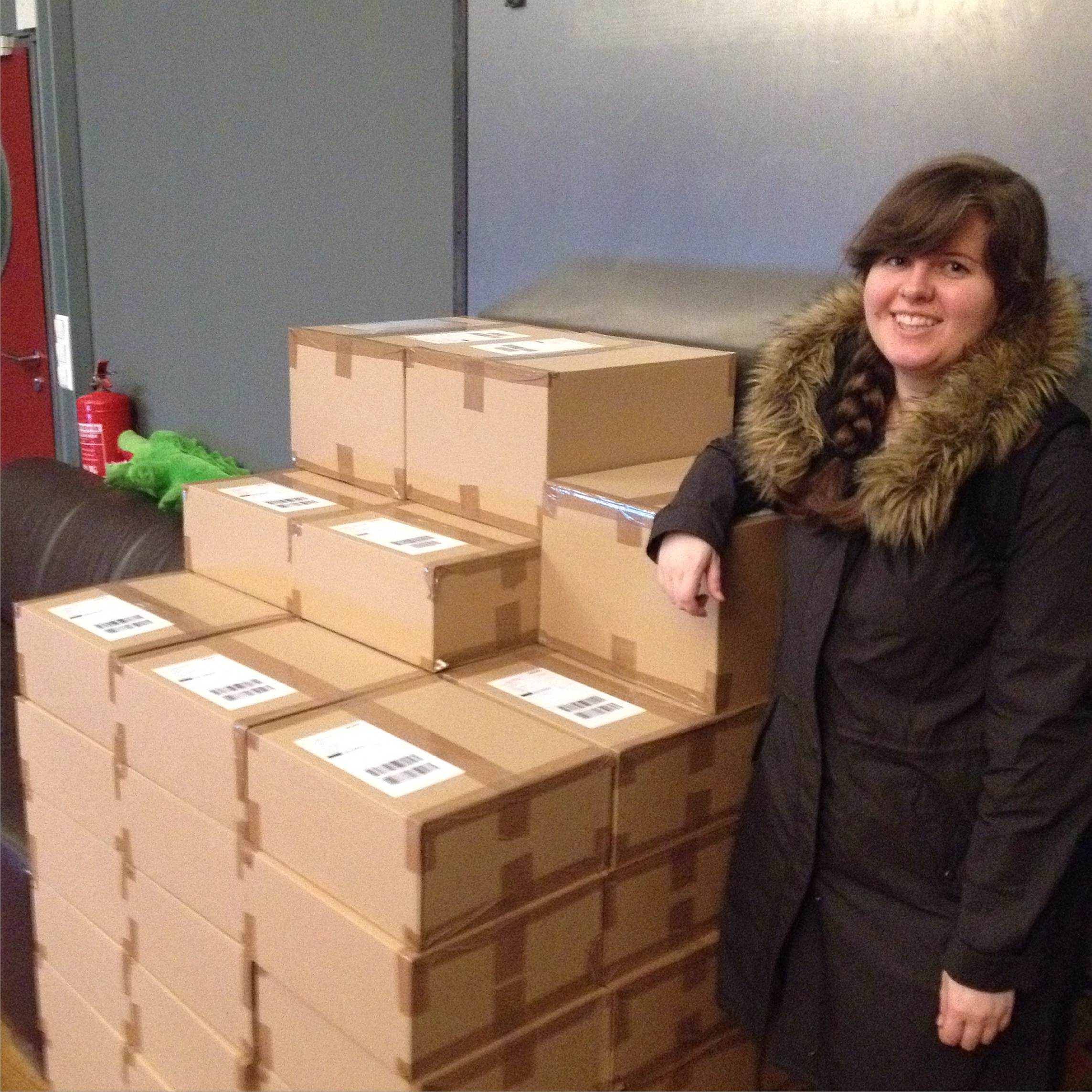 Kits awaiting pick-up for delivery! (Anne posing for height reference)