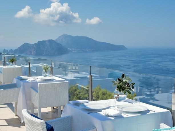 HOTEL VINCENZO - A modern boutique hotel in the hills of Sorrento. This venue boasts spectacular views which make Capri appear within touching distance.Read More...