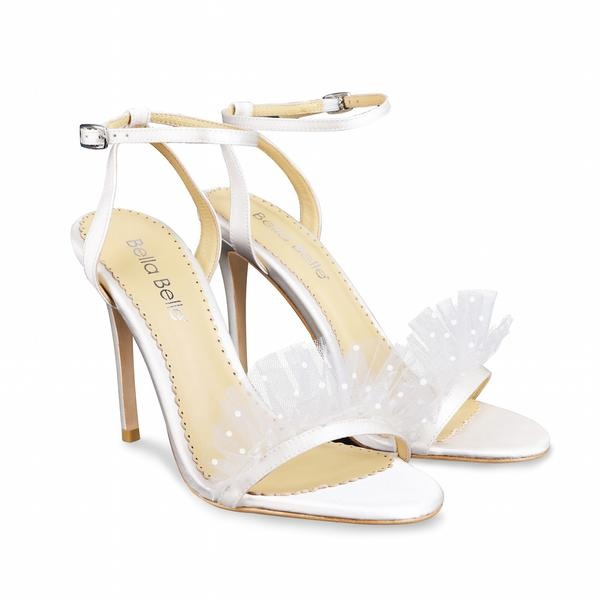 Bridget by Bella Belle - I like these shoes because something about them seems rather fun and romantic!Available for $259 at https://www.bellabelleshoes.com/collections/all-wedding/products/bridget-polka-dot-and-pleated-tulle-ivory-wedding-heel