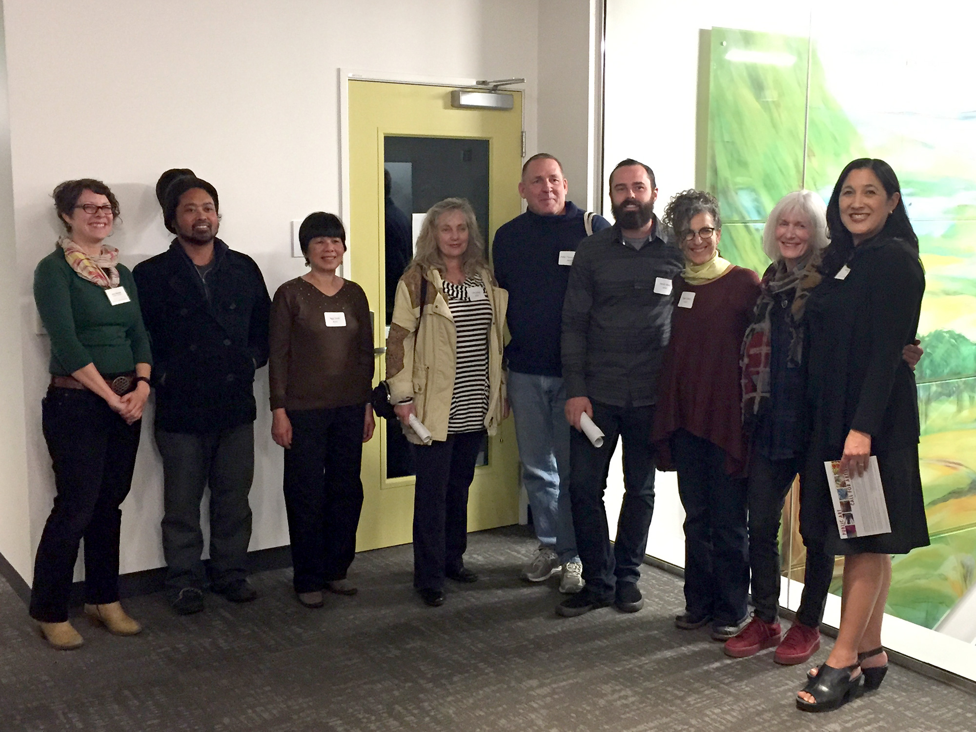 Group shot from the artist building walk-through: From left, Amy Stimmel, Public Art Program Coordinator, a few of the selected artists, and Rachel Osajima, Director or the Alameda County Arts Commission (right).