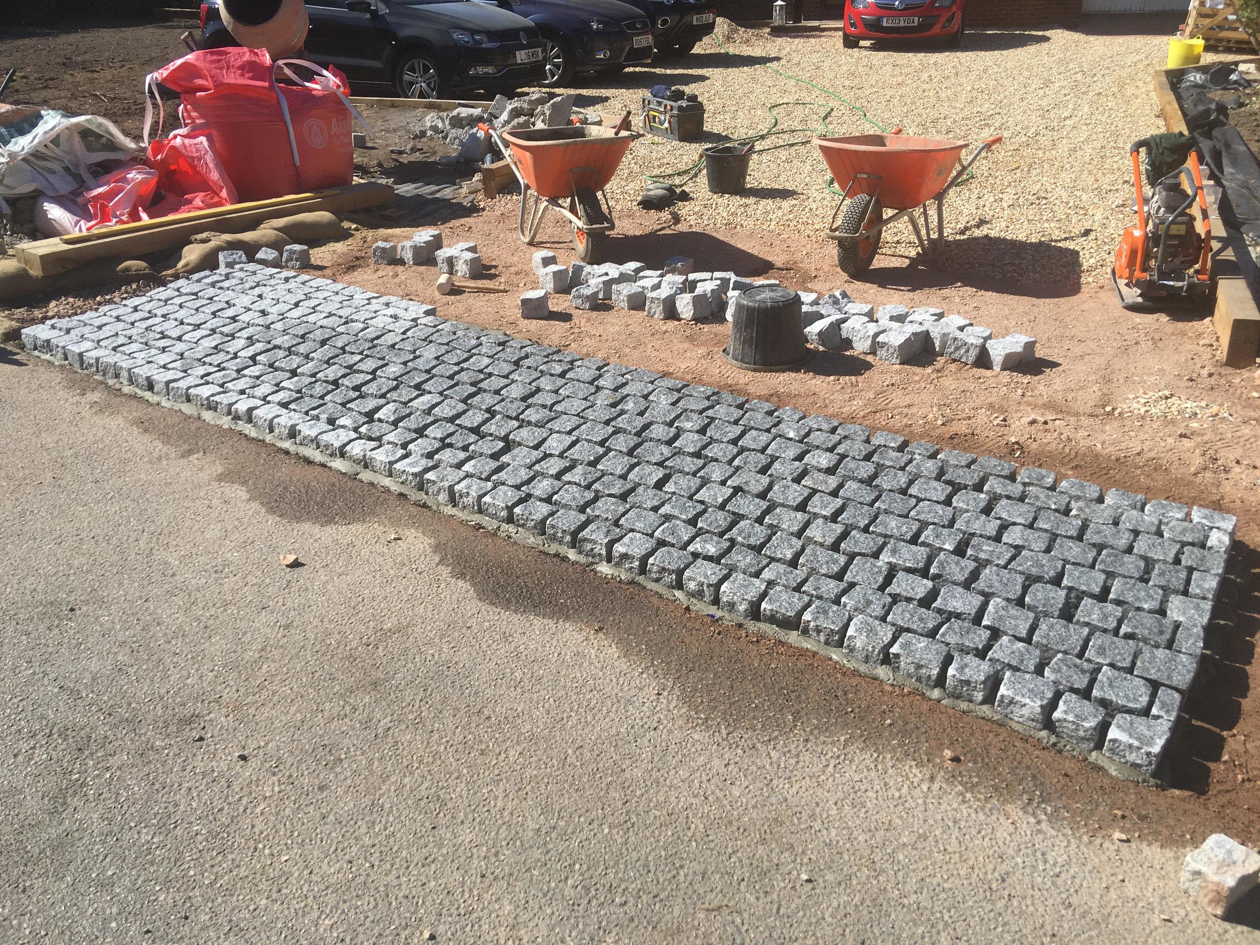 Horlsey driveway granit setts.jpg