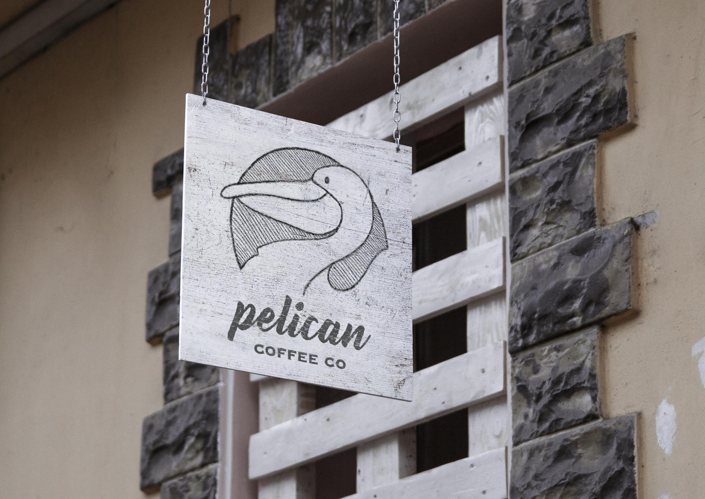 HangingSignMockUp_pelicancoffee.jpg