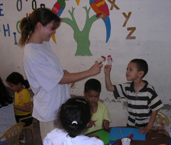 Doing art projects with children in Morocco. For free. I wore the same clothes for three days because my acrylic paints exploded in my suitcase on the flight there.  How unprofessional.