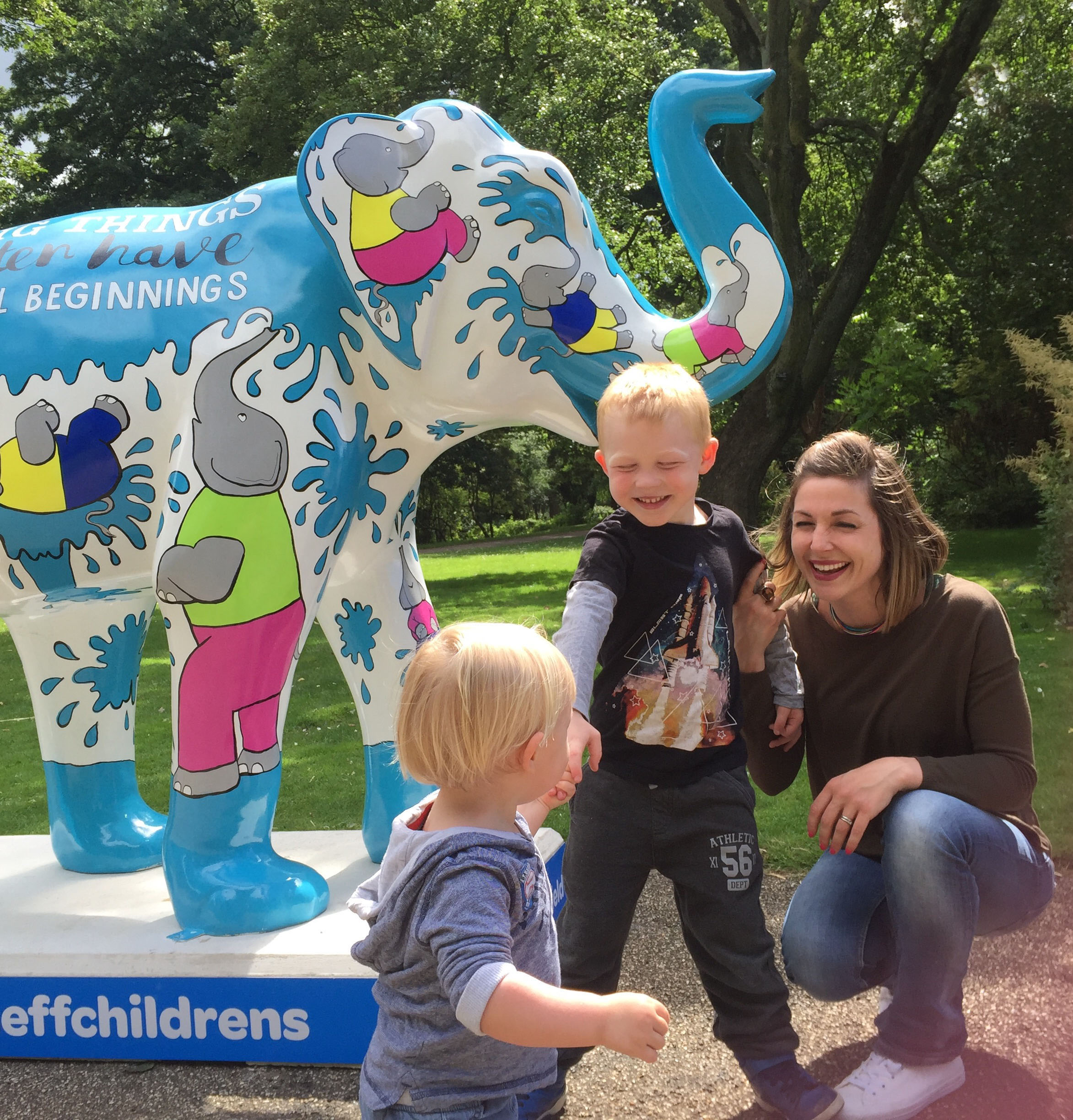 Here's me and my kids by this elephant I painted which sold for £7600 to raise money for the The Children's Hospital Charity in Sheffield. I had to see that money go towards saving lots of children's lives instead of taking my children to Disney Land, Bernard. It was so unfair.