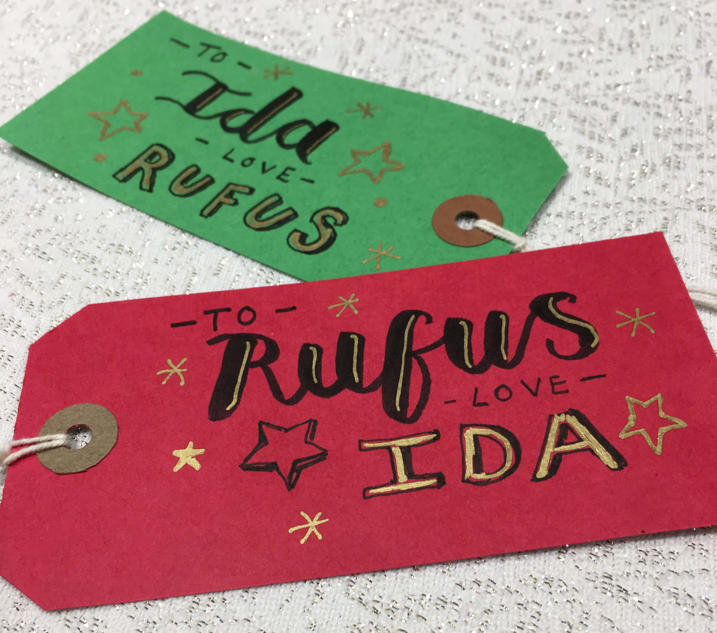 I wrote out Stu's poems on gift tags and hand lettered names on the reverse so they could be attached to gifts.