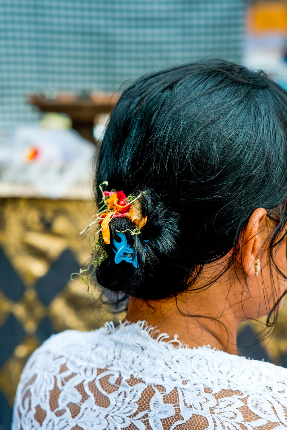 A paradise where women of all ages wear flowers in their hair.