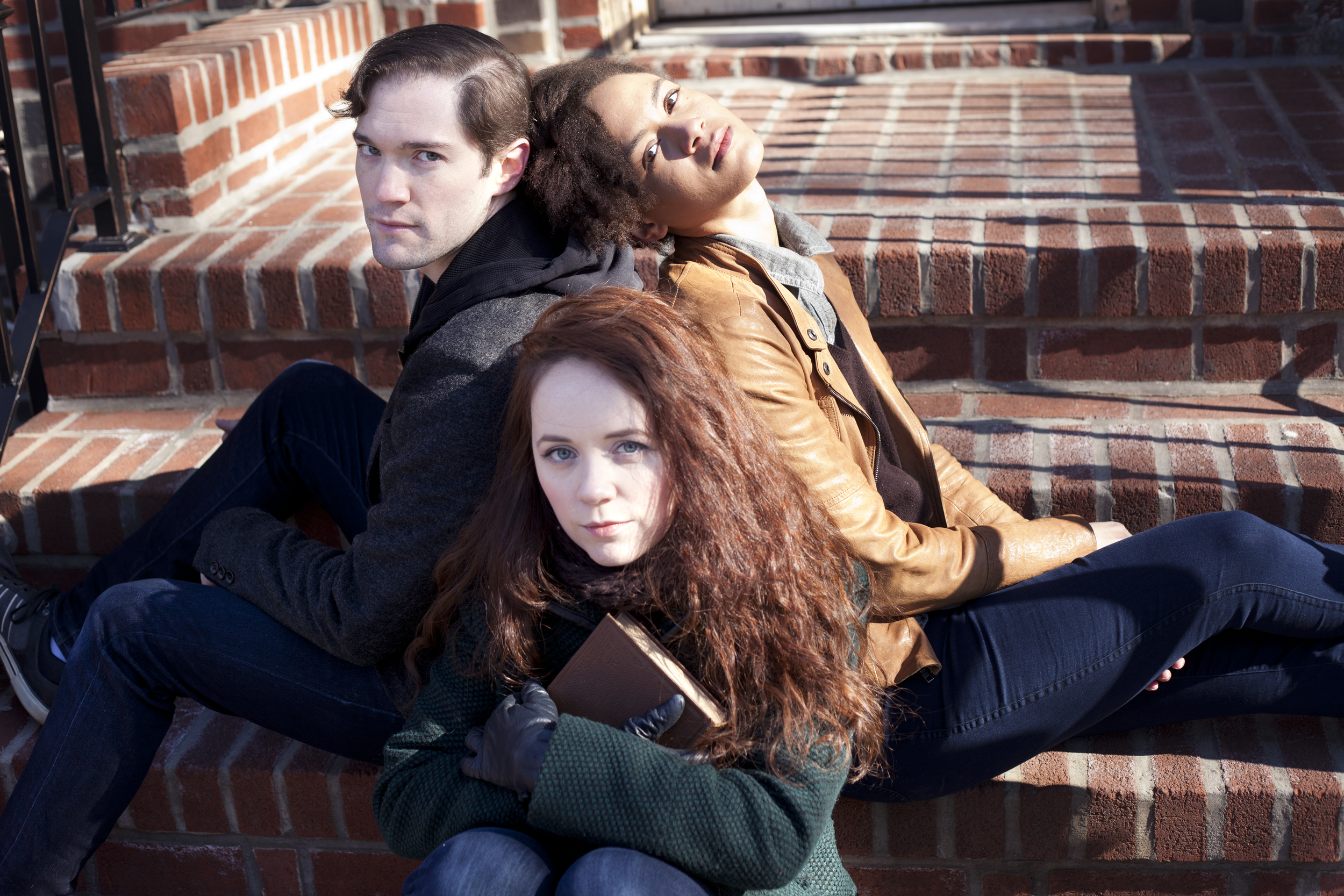 Promotional image for May Violets Spring featuring James Parenti, Monique St. Cyr, and Gwenevere Siscoin Astoria. Photographs by Trish Phelps .