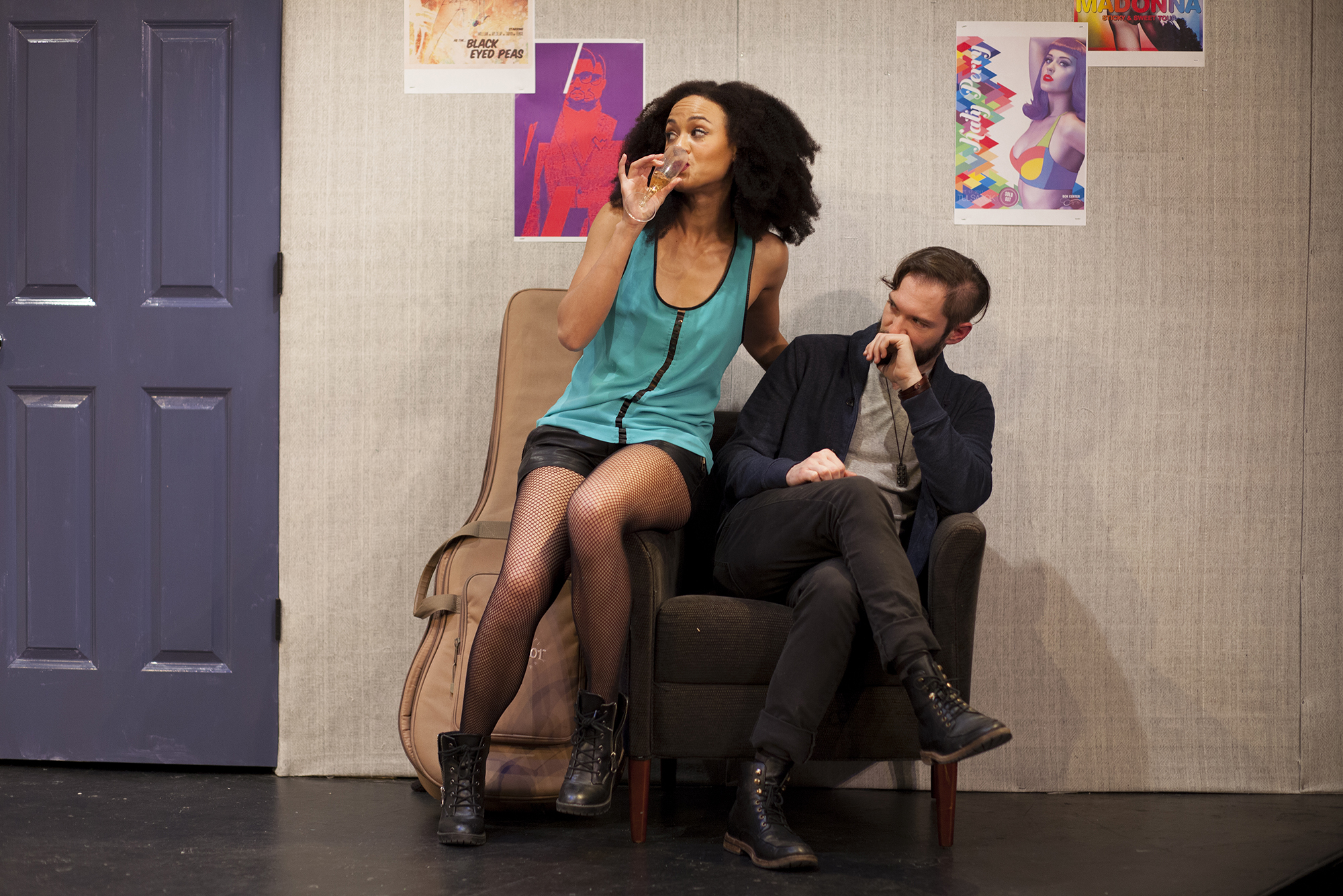Production image of Monique Jackson (Monique St. Cyr) and James Pearce (James Parenti) in  POPTART! when produced by  Girl Just Died at TADA! Theatre in Winter 2015.Photograph by Trish Phelps.