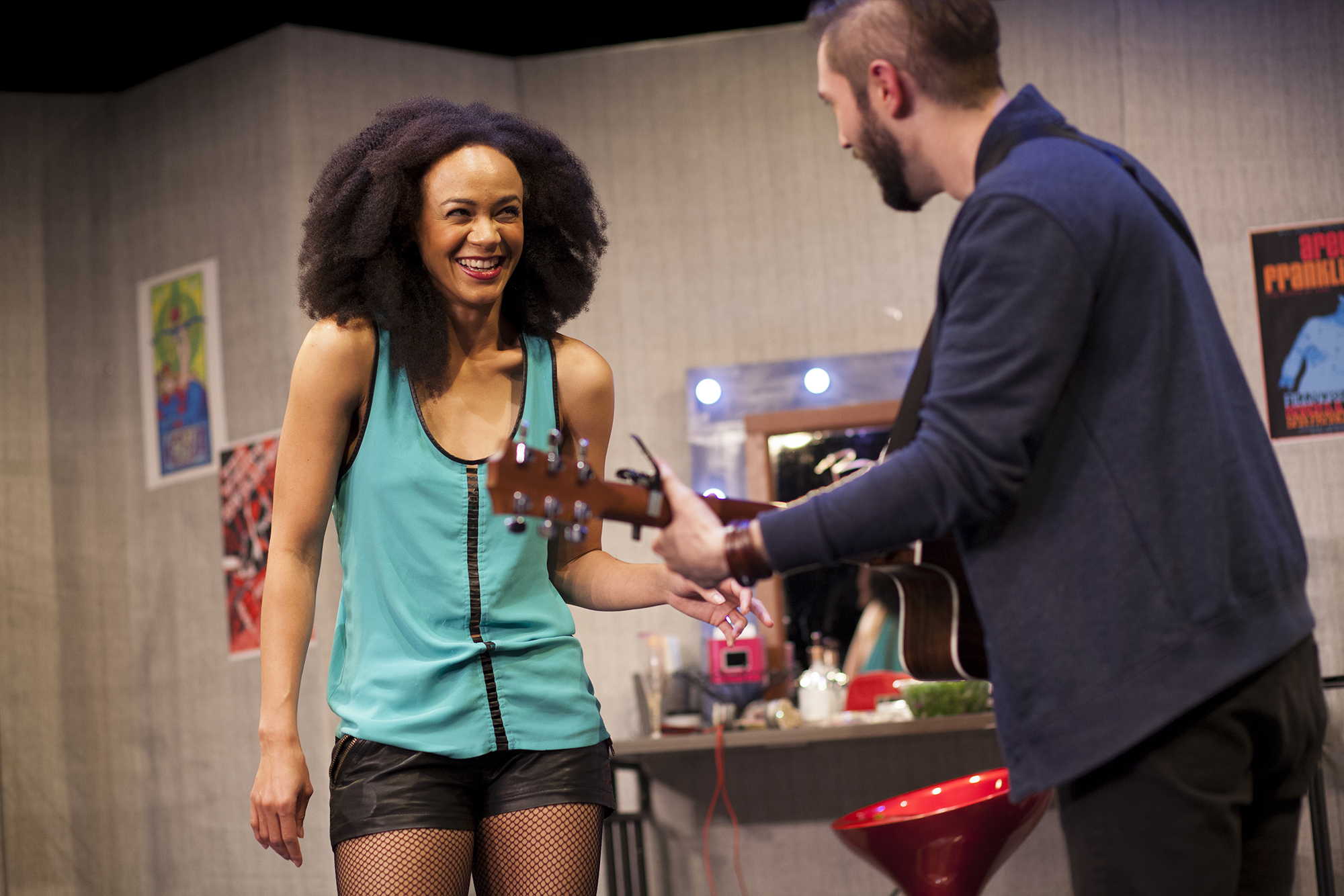 Production image of Monique Jackson (Monique St. Cyr) and James Pearce (James Parenti)in  POPTART! when produced by  Girl Just Died at TADA! Theatre in Winter 2015.Photograph by Trish Phelps.