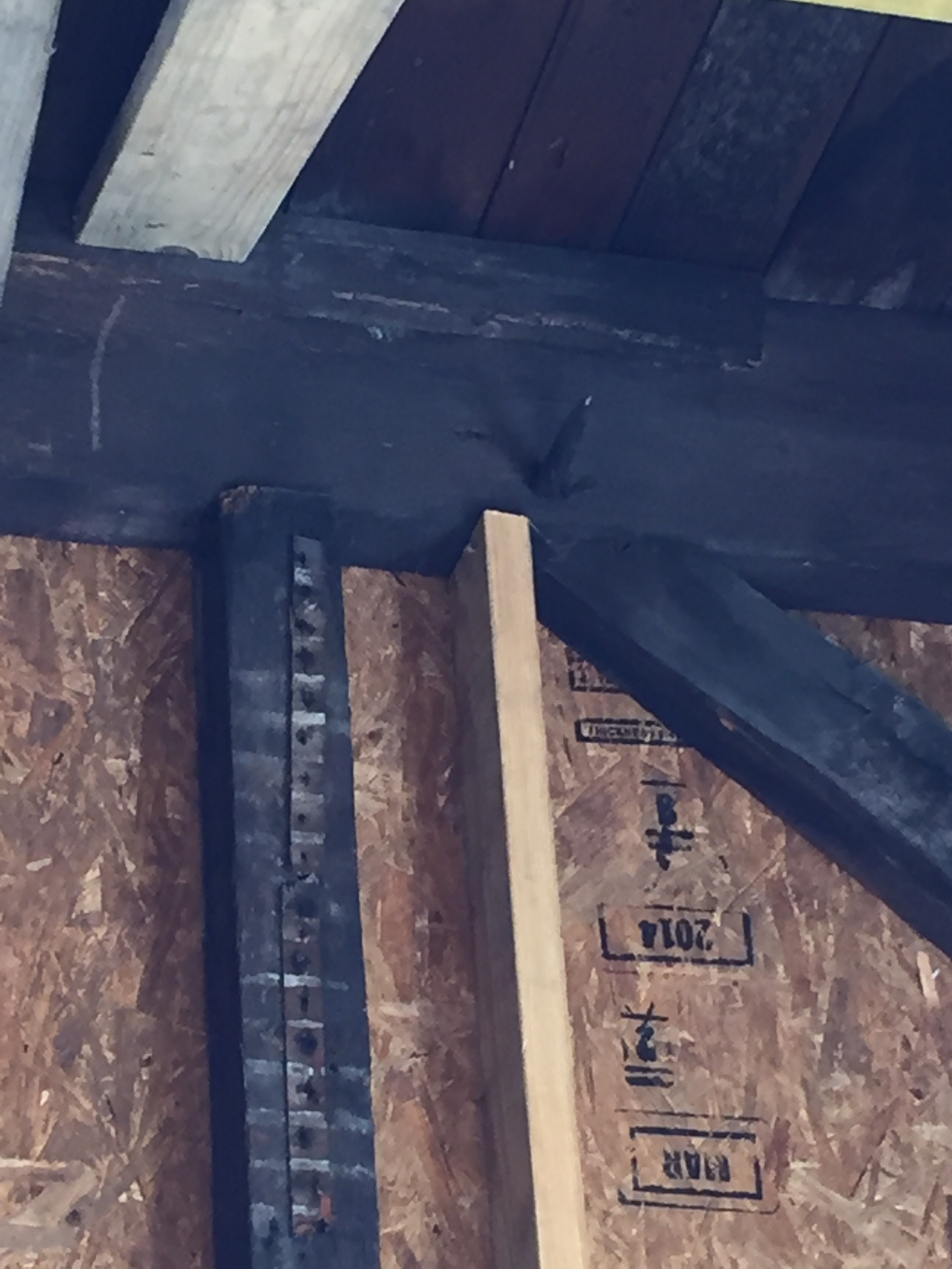 Closeup view of old beams notched together and pegged in place.