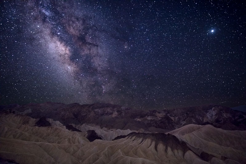 Milky Way over Zabriskie Point, Death Valley National Park. Note Jupiter in the upper right.
