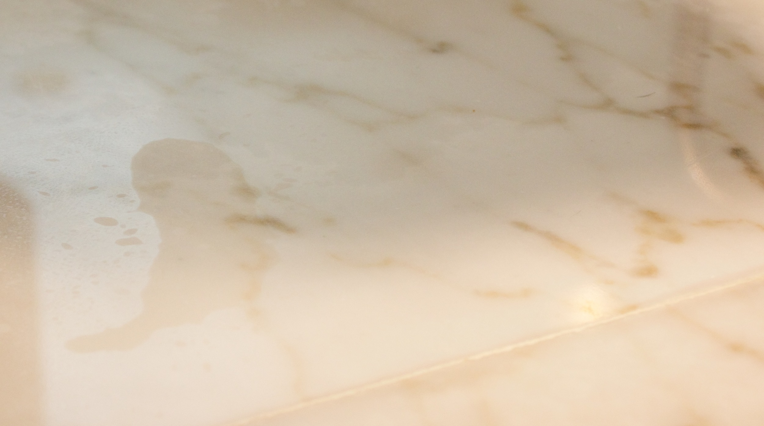 Close up of an etch mark on the gorgeous Valley Gold Vein countertop