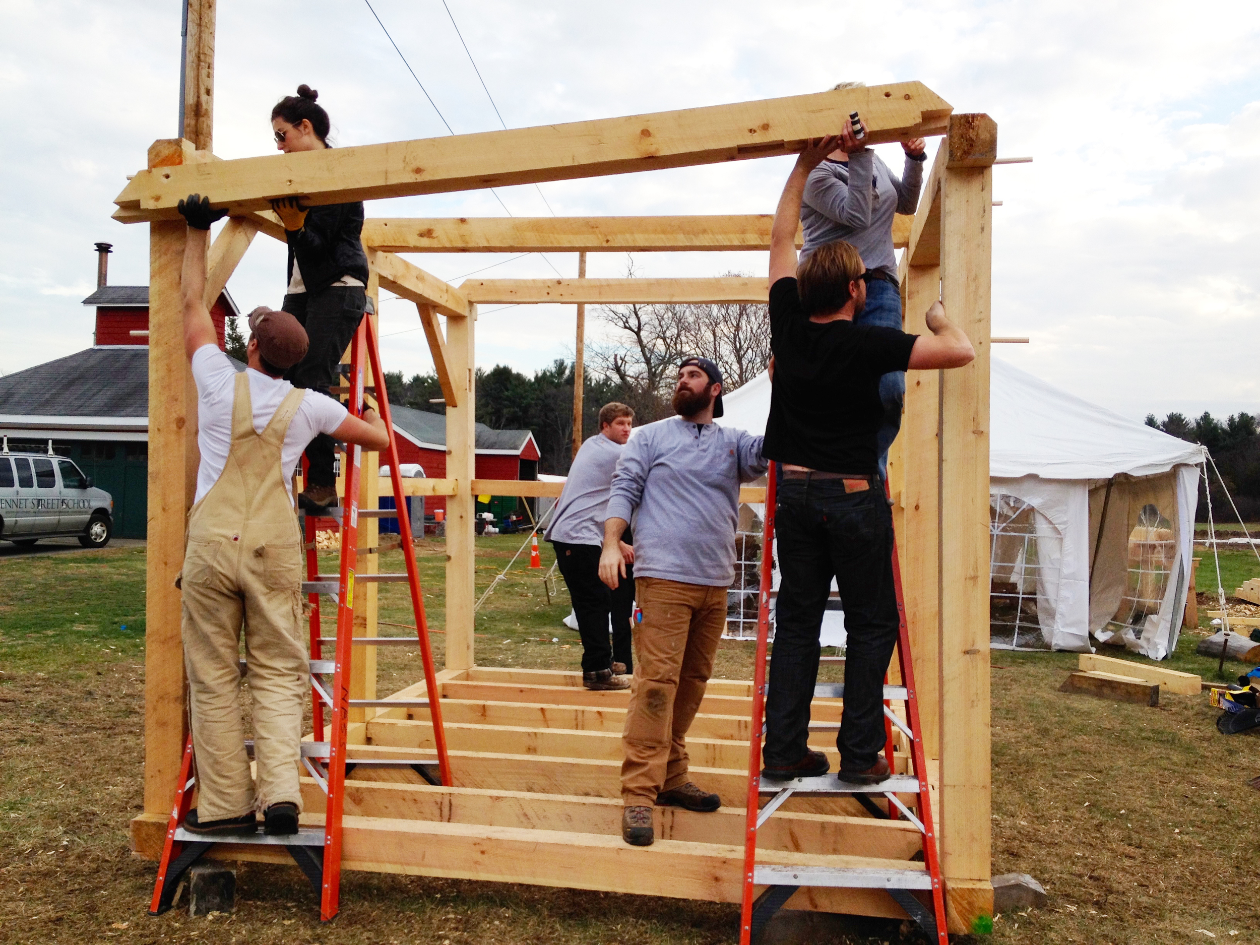 """""""M  y classmate, Liz and I raising a timber for a 18th century style barn."""" 