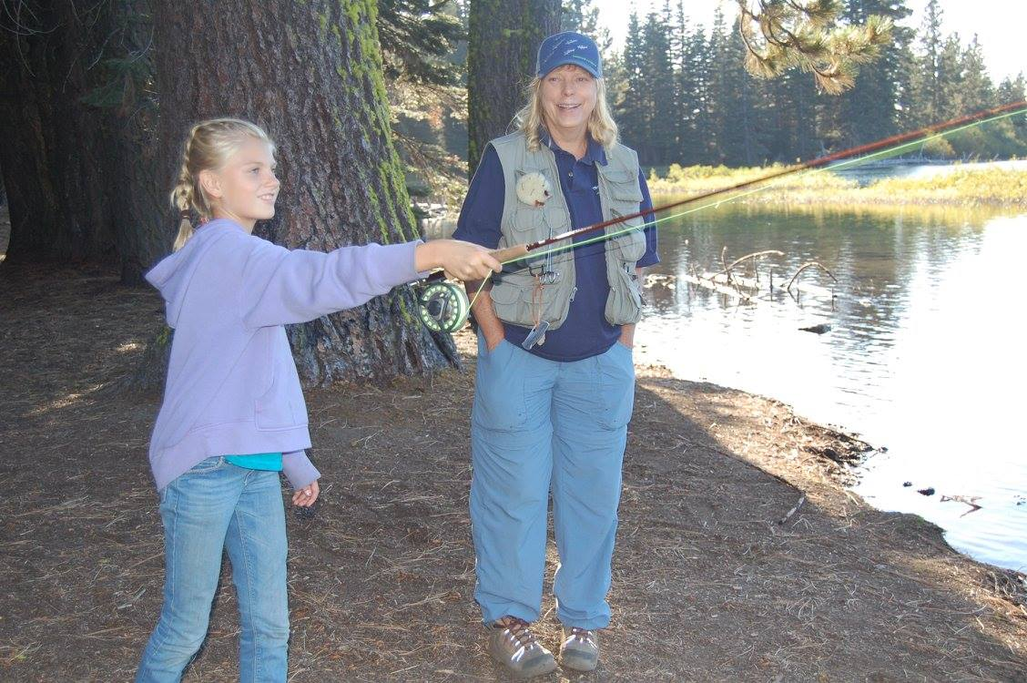 Feather River Trout Unlimited Member, Holly Coogan, delivers a pointer here and there for up-and-coming casting champion.